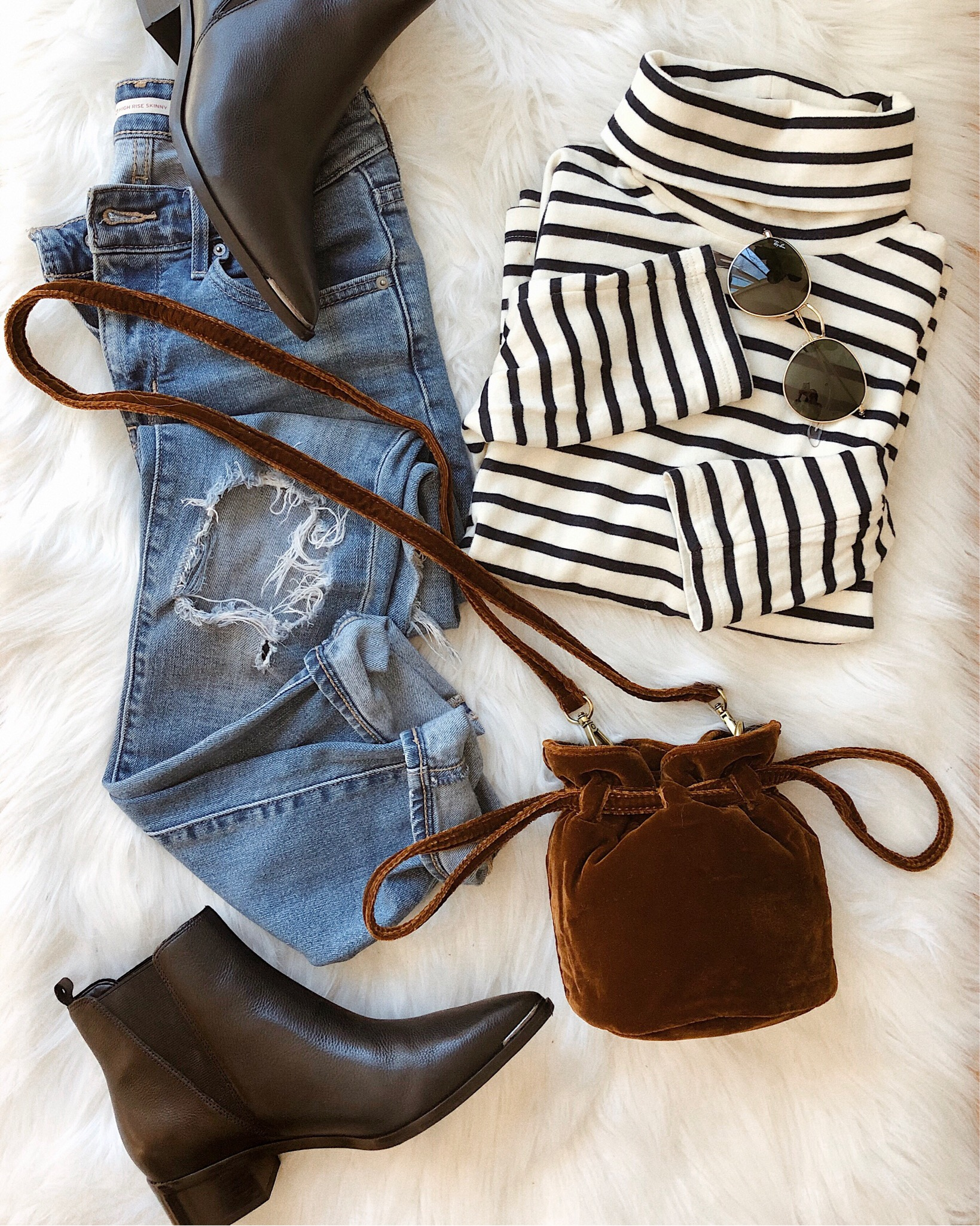 striped top and jeans flat lay