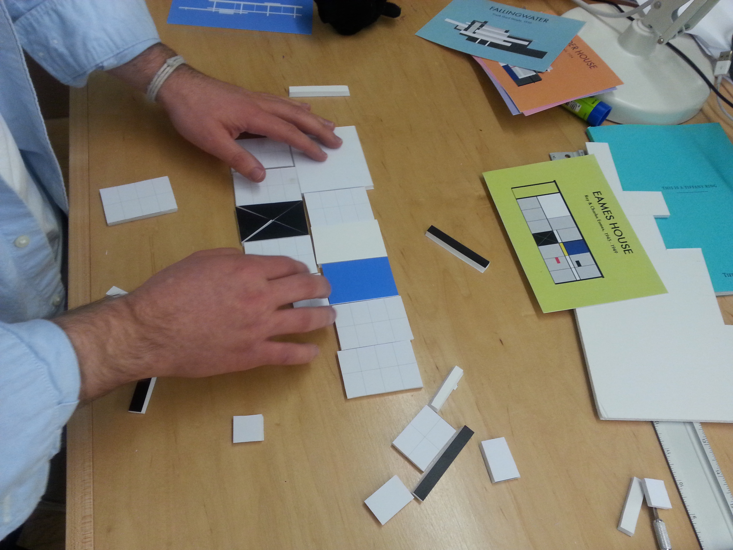 Prototype 2: foam core tangram pieces that assemble to form the buildings illustrated in the flashcard.