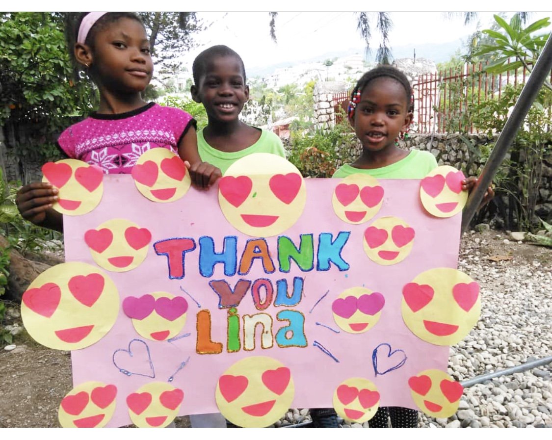 Haitian children thanking Lina Condes