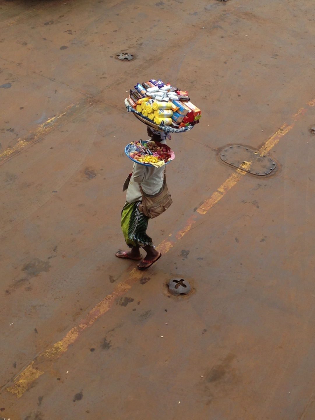 Woman selling biscuits on Lungi to Freetown Ferry. I  bought some biscuits.