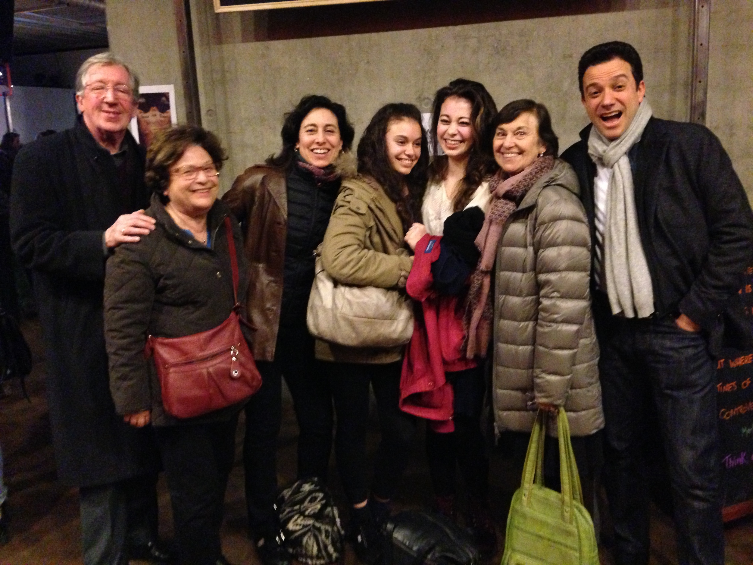 Sarah and her husband Alain with family and friends including daughters Ambre and Lara
