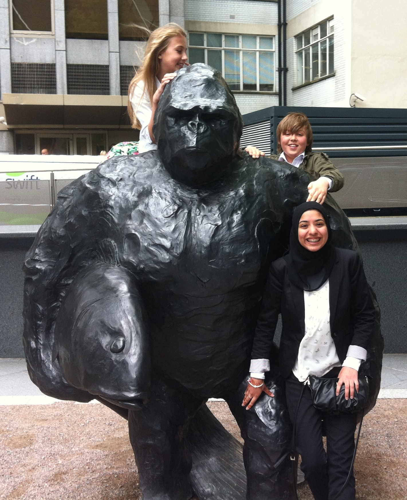 L to R - Fiona, Ben and Fatema enjoy the Gorilla with his Fish.