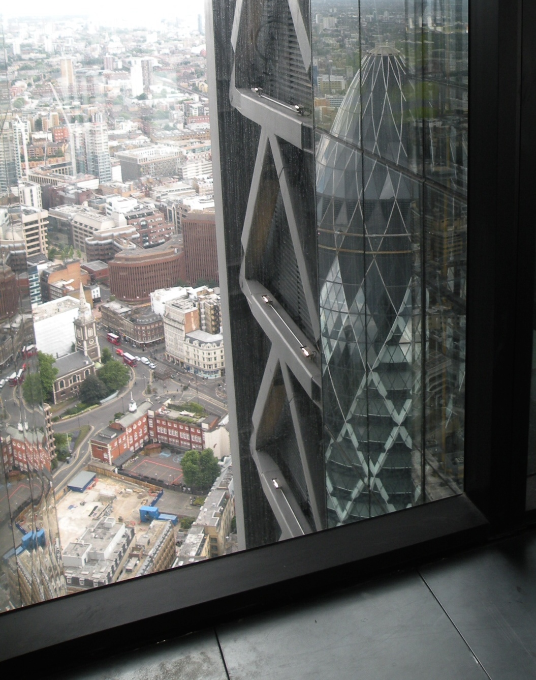 The Gherkin reflected in the Cheesegrater