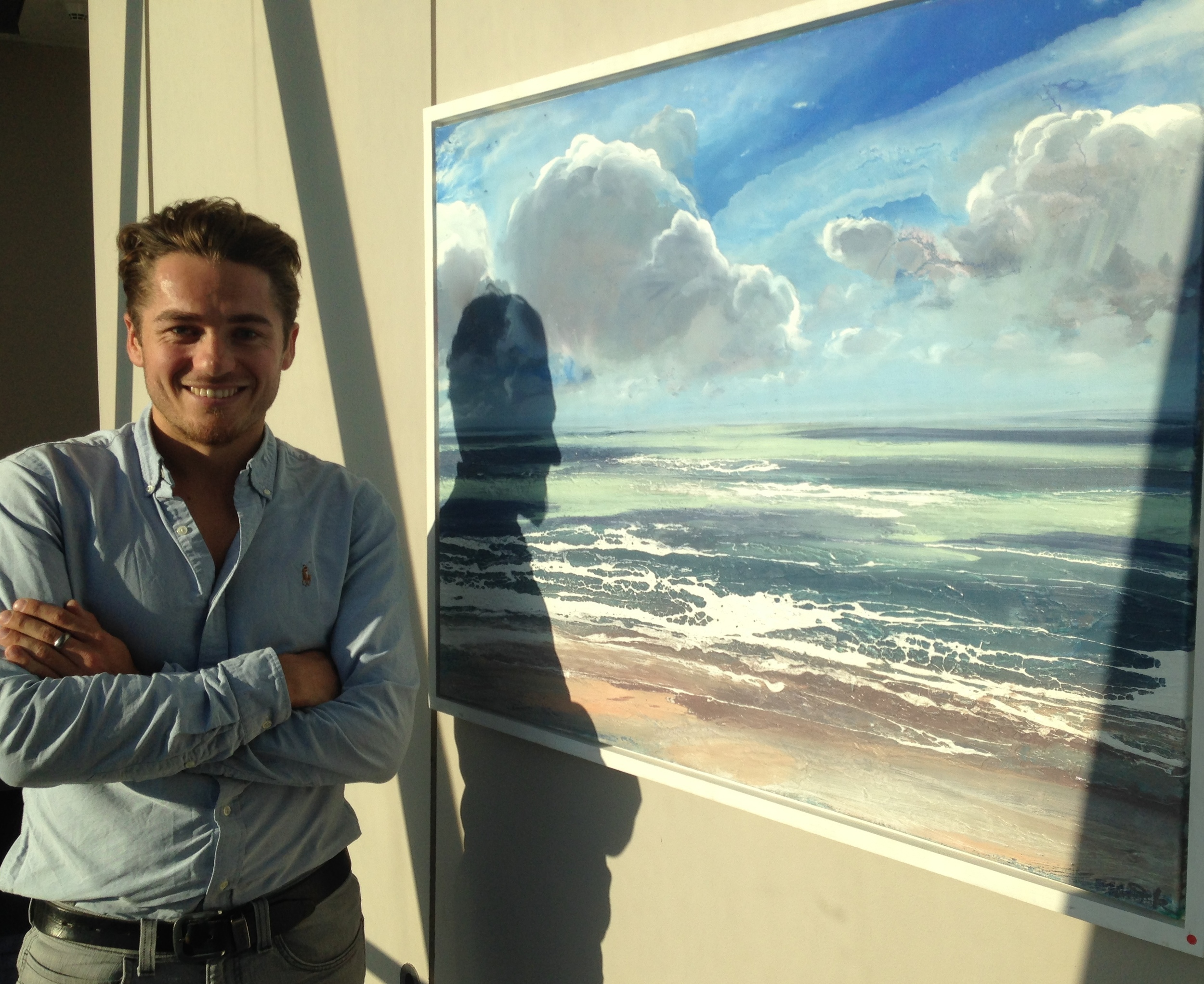 Michael Sole with one of his paintings on display in the 38th floor art gallery in The Gherkin