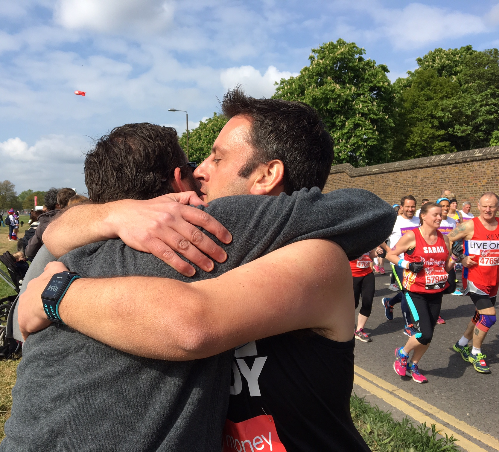 I loved this moment when a runner spotted his cheering friend in the crowd and stopped for a supportive hug. I snapped it and, after everyone passed,sent it to the friend who immediately sent it to the runner's family.