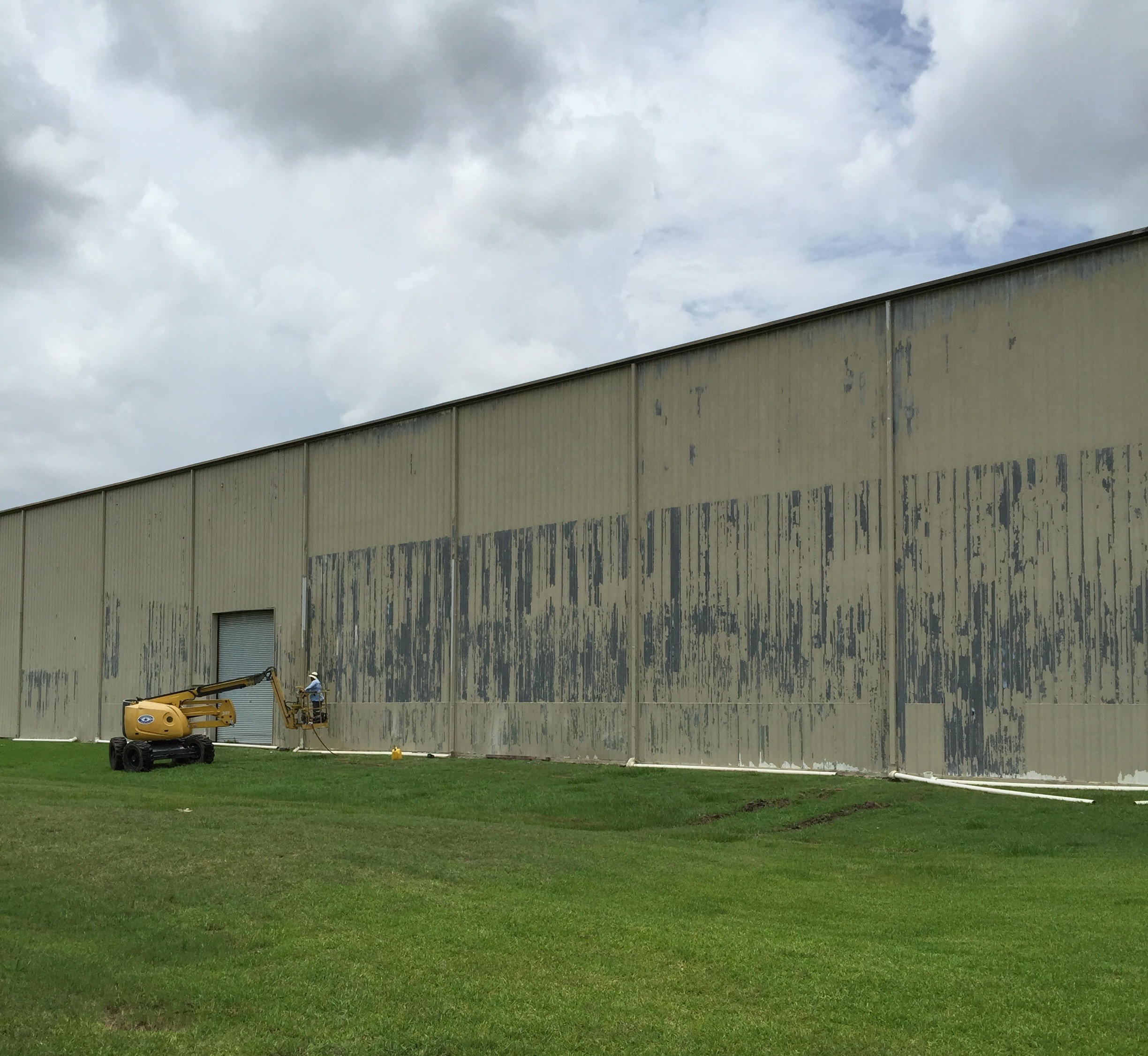 Metal building Painting Contractor.  The exposed galvanized surface must be primed with a special primer.