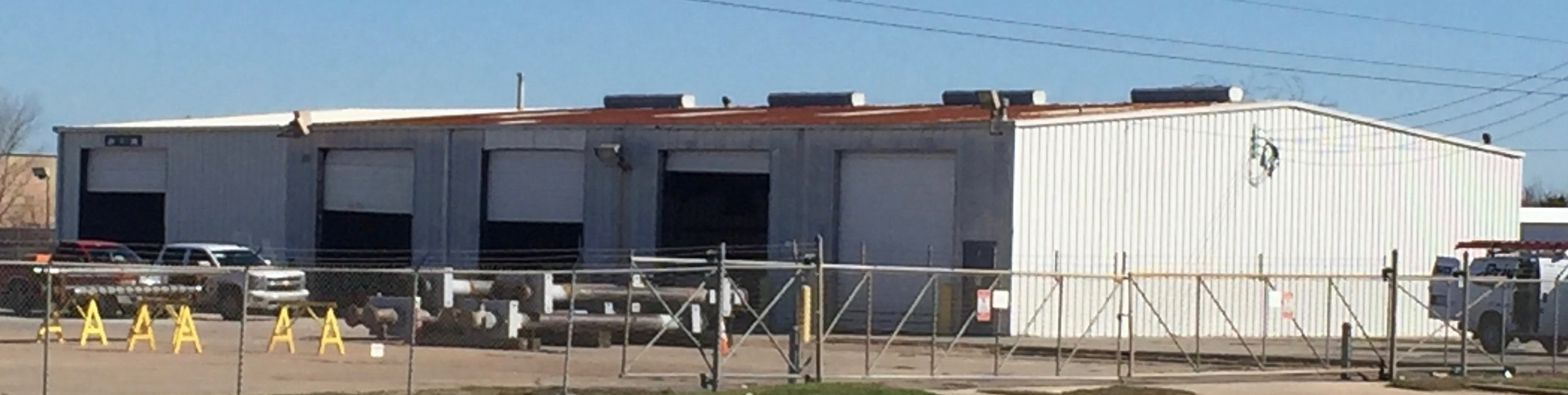 Before, abandoned, ignored. Front view. Metal roofing contractor, metal building renovation project.