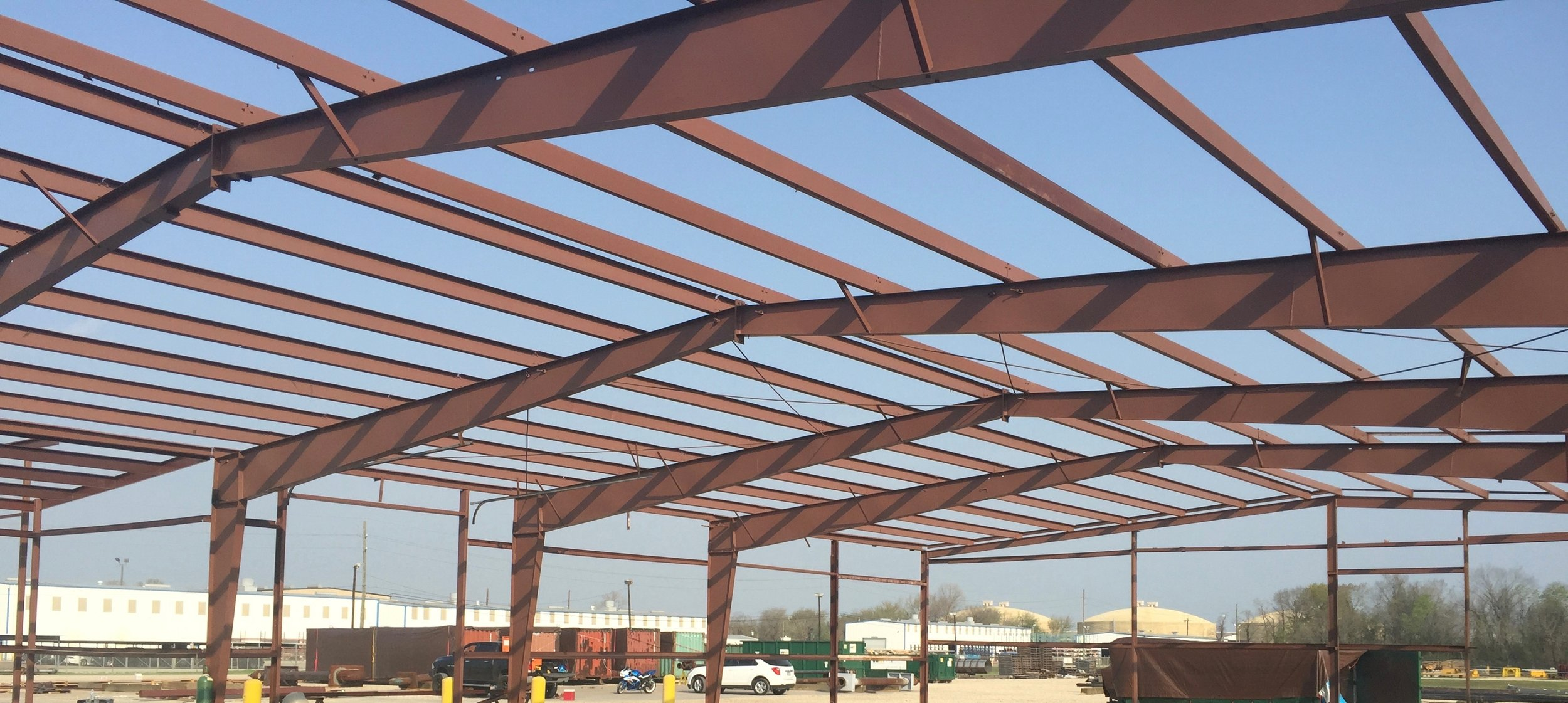 Because this building was not in use we were able to open it up to allow the work to be accomplished more efficiently. After purlins replaced, frame cleaned and painted.