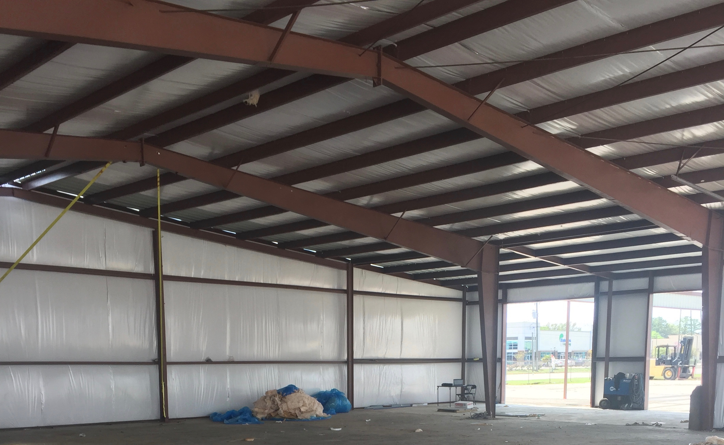 Metal building insulation replacement renovation. in process