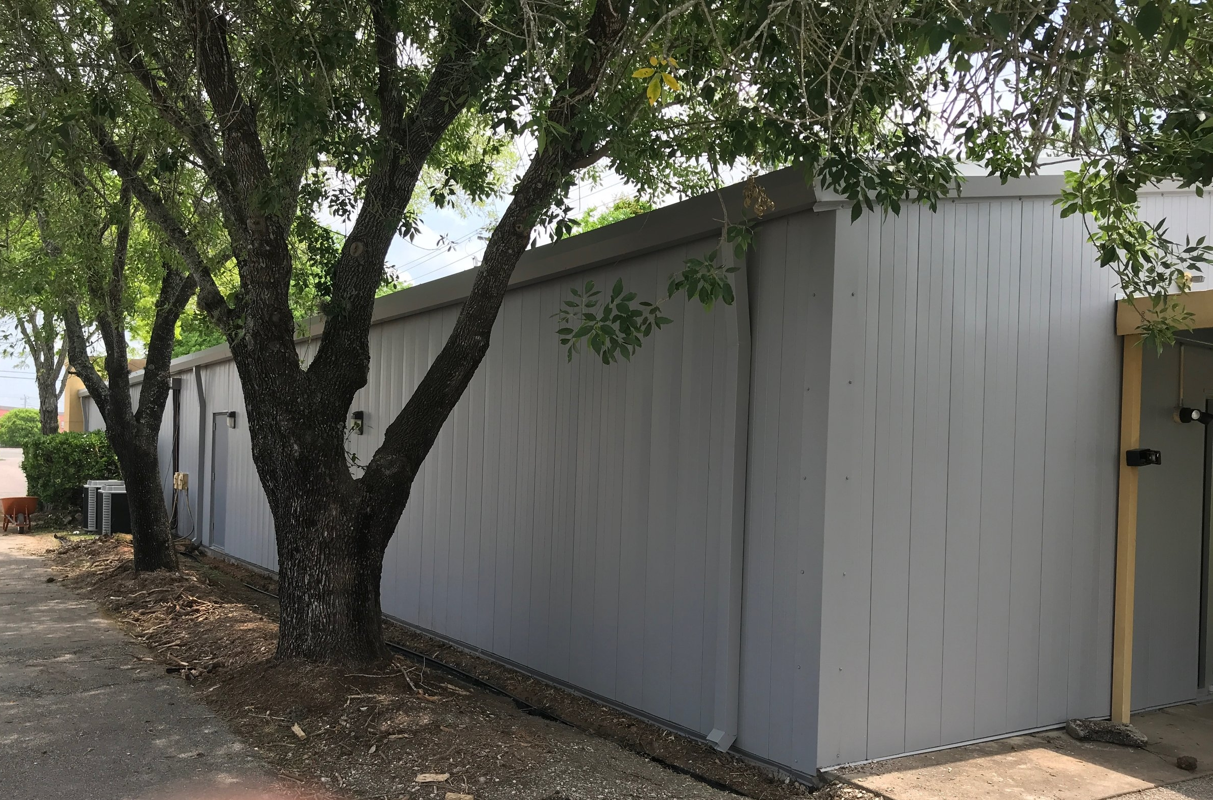 Finished wall panel and gutter replacement, One of many metal wall panel replacement options