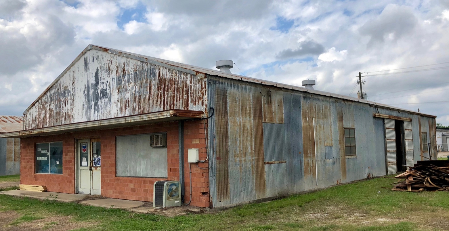 Before a metal building renovation. Metal wall panels and metal roof panels were old and replaced.