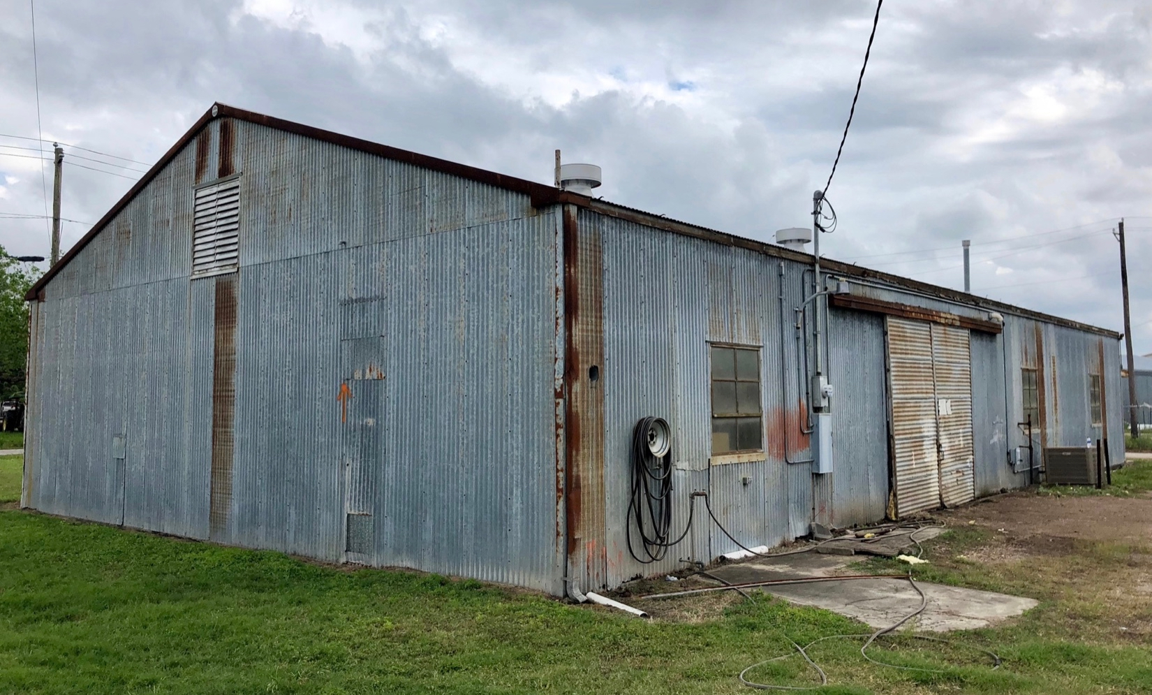 Metal building wall, roof and insulation replacement. Metal building restoration.