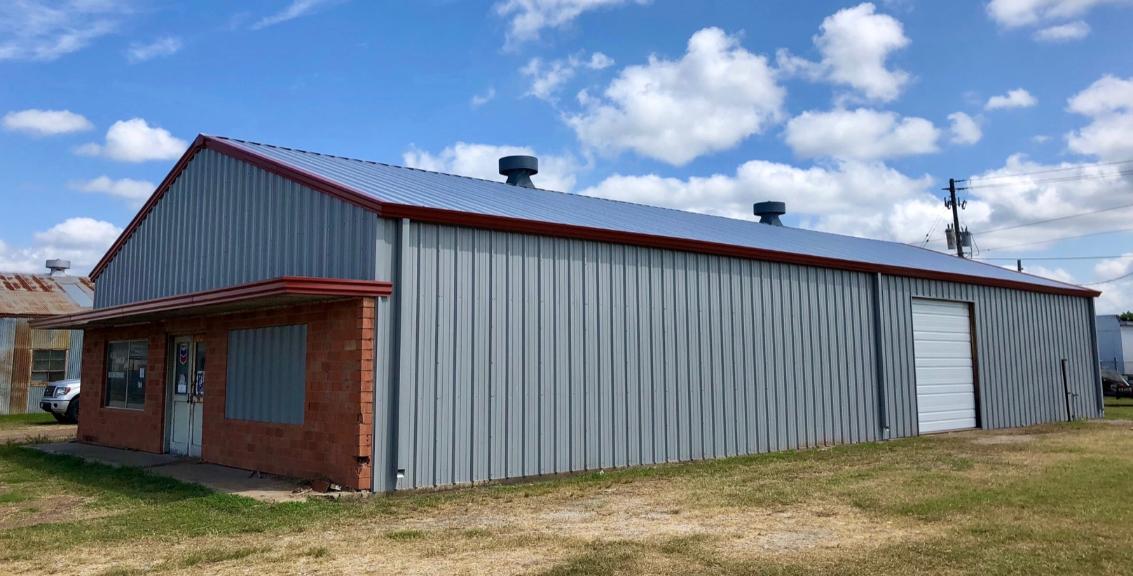 Looks like new. Rusted metal roof replacement, metal building wall panel replacement. Framed out and installed new overhead door.