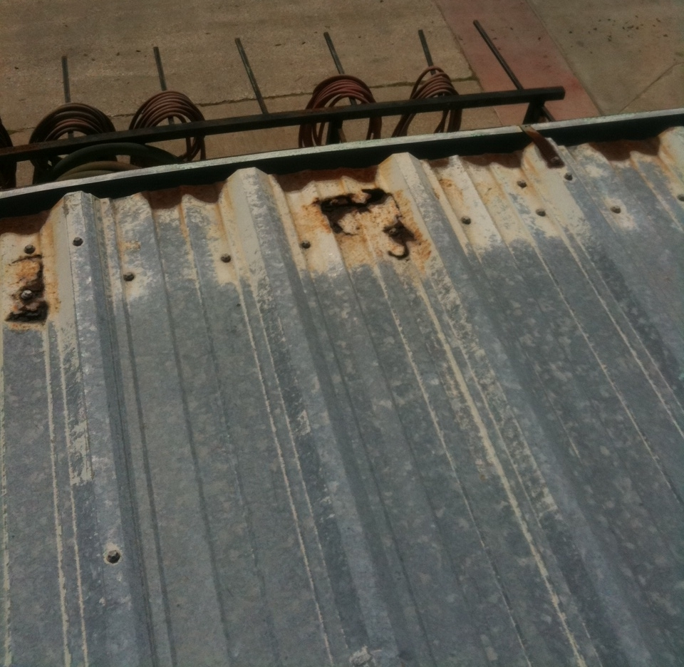 Metal roof leak repair - Metal roof cost and paste before picture. Met building roof panel that were rusted out at the eave, eave leaks on a metal roof due to failed closure.