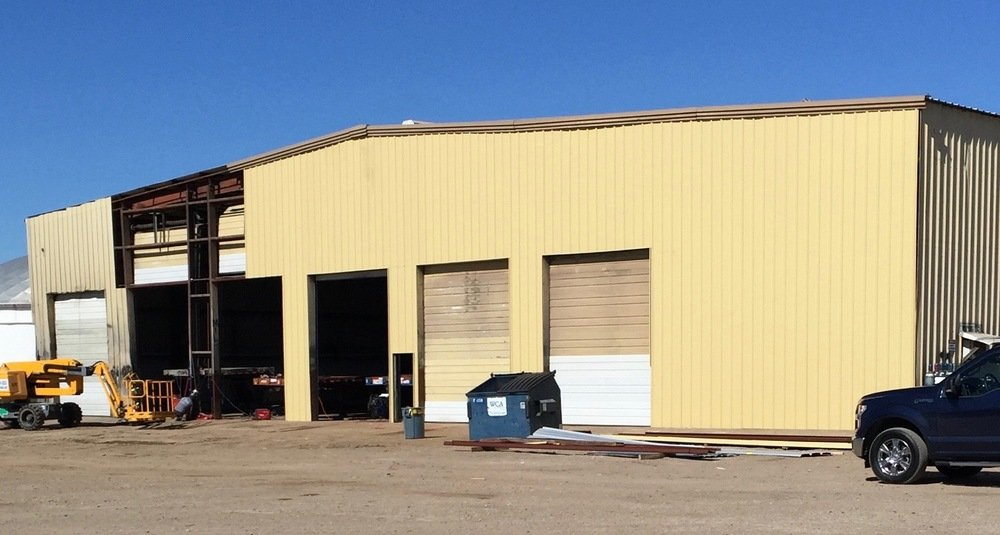 Metal building wall panel repair in process