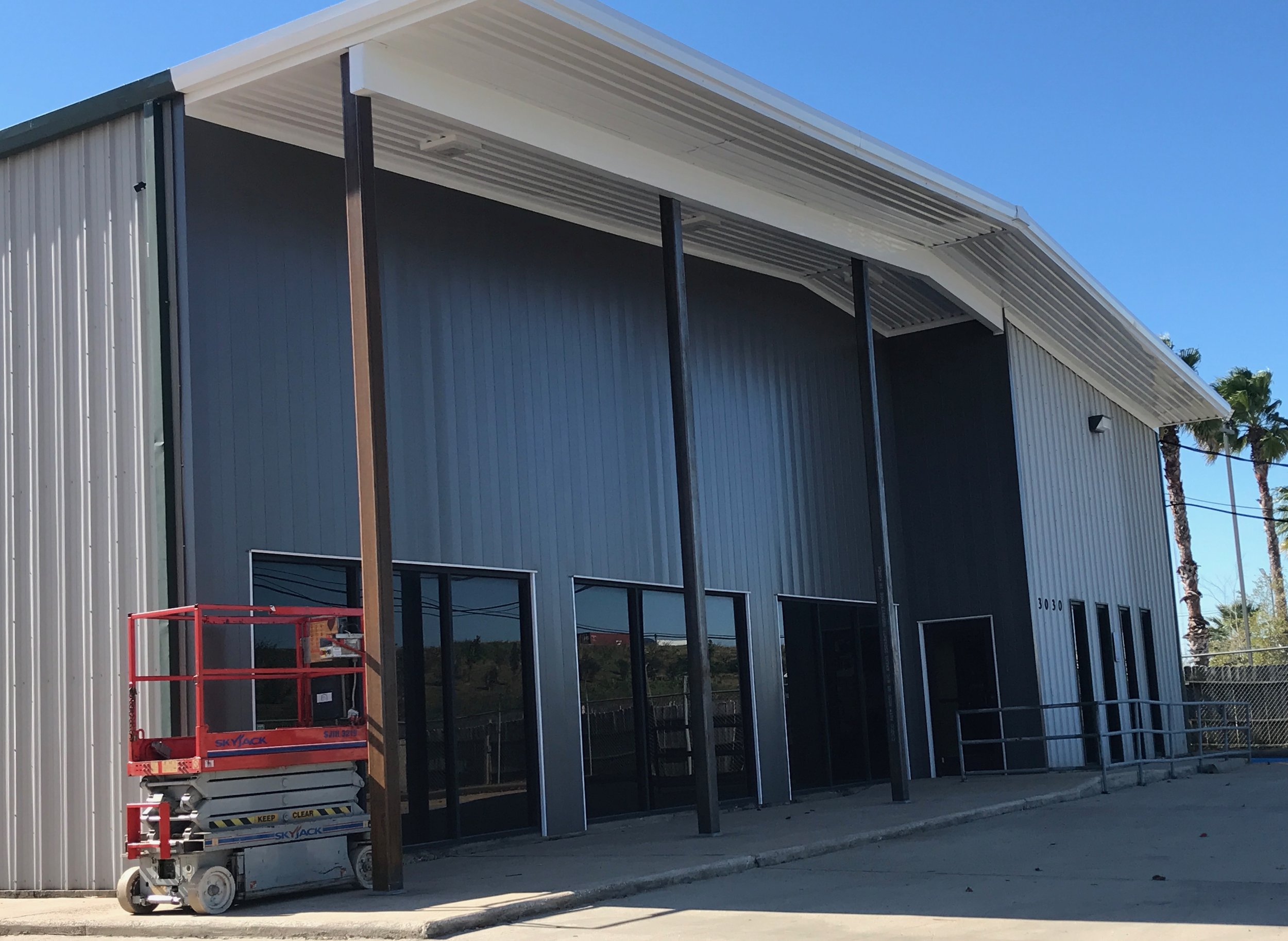 At completion, we used a hidden fastener panel system on the new panels on the front wall. I gives an industrial metal building the finished look of a commercial building.