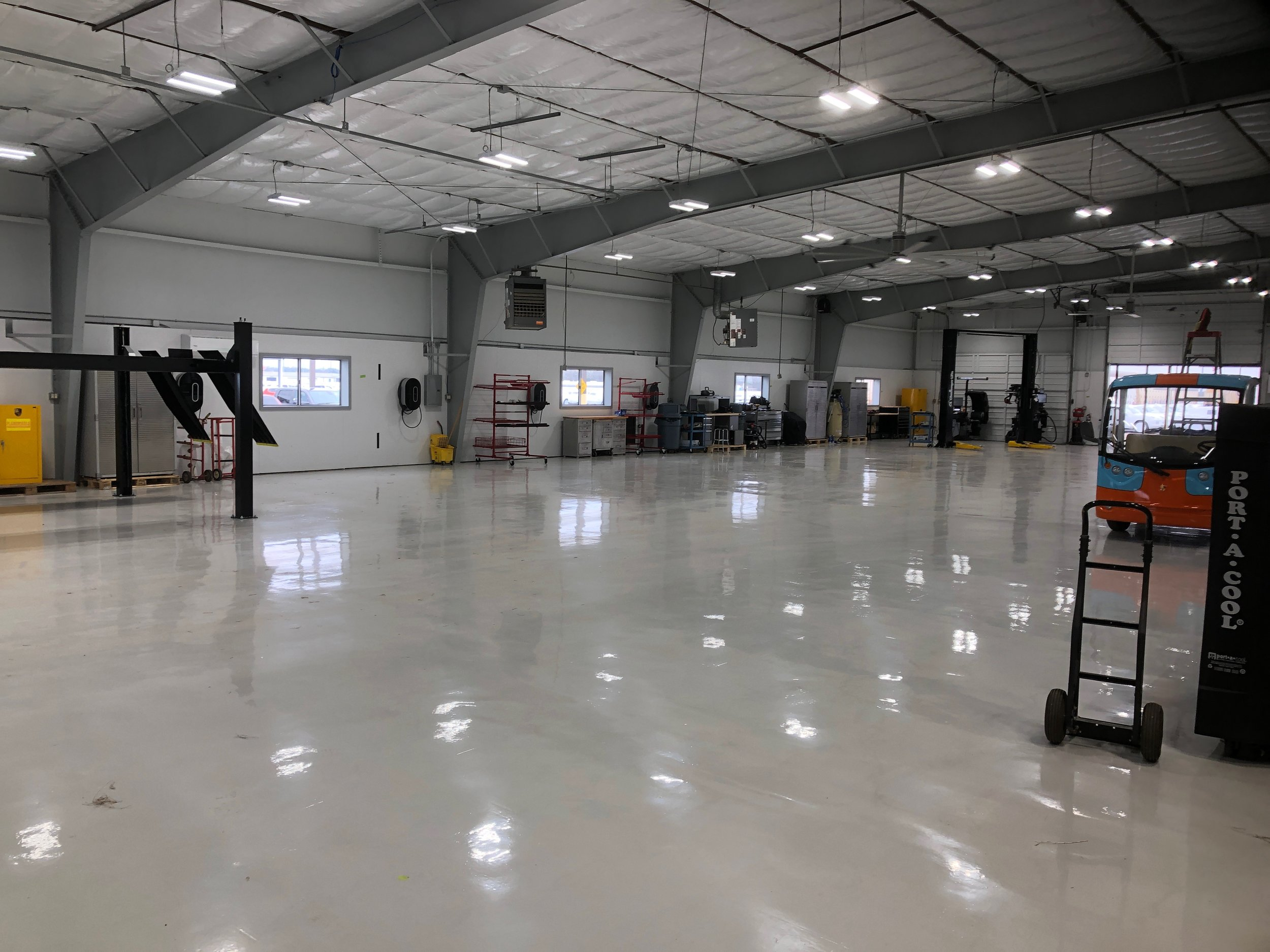 "This was a complete Metal building renovation performed by Metalguard; New floor coating, walls and columns painted, new lighting system, 8"" insulation, R-30, retro-installed insulation into the ceiling in this metal building. It is beautiful. Completed January 2019. This is helping to keep the building cool"
