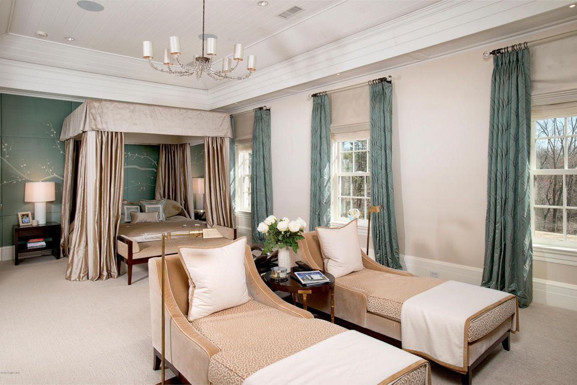 master suite with canopy bed and double chaise lounges