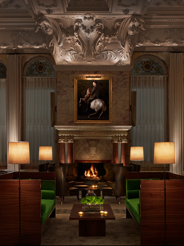 lounge by the fireplace. love the pops of green.
