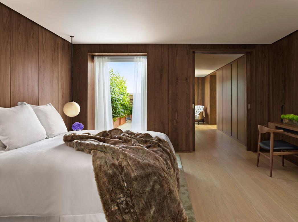 Sleek and sumptuous bedroom.