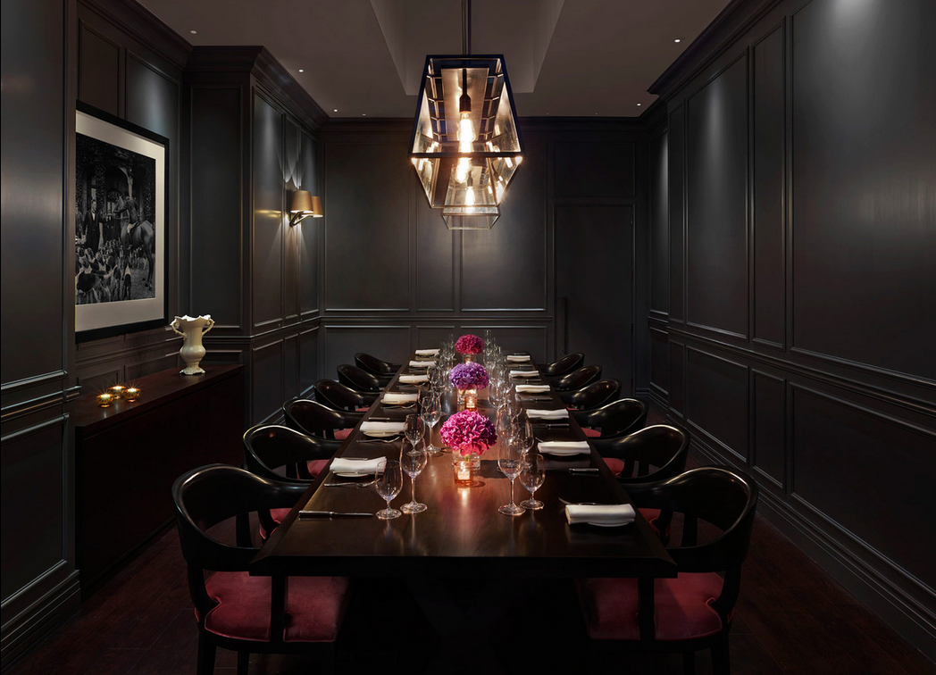 Super dark and moody dining room inspiration. Paneling throughout, soft lighting.