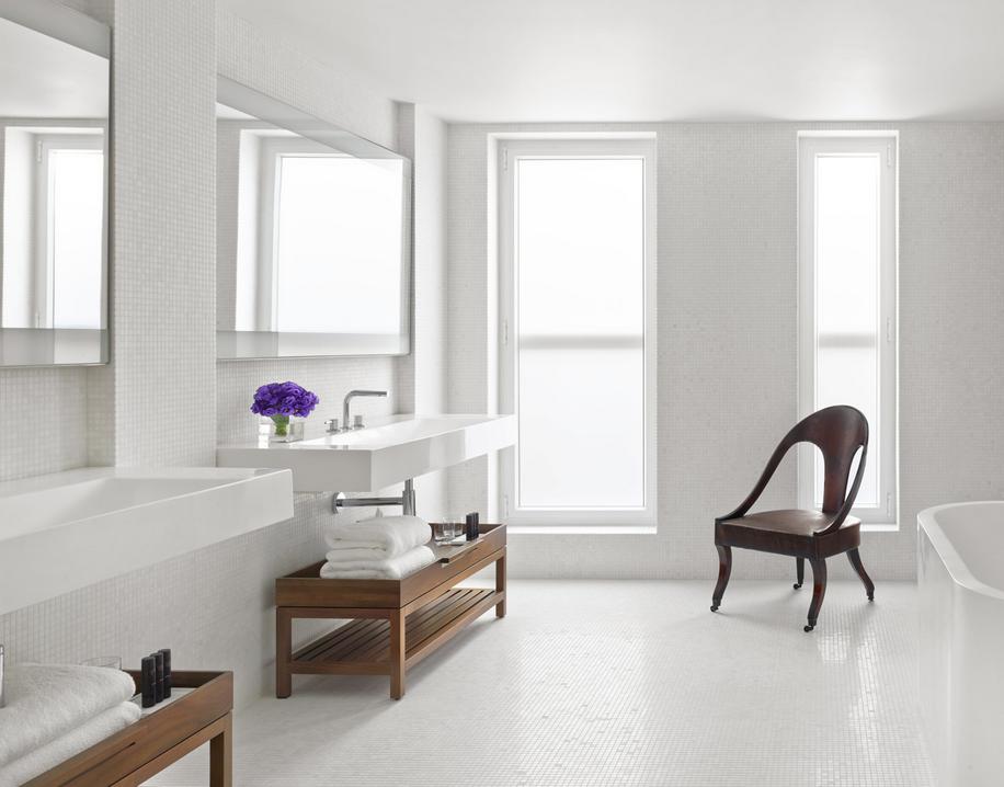 Clean and minimal bathroom. Natural light, floating vanities.