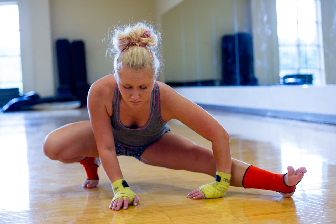 Sheeley stretches before beginning her training session at the Ping Center on August 31, 2015, in Athens, Ohio. Sheeley stretches for at least ten minutes before every training session to prevent injury while training. (©2015 Sarah Stier)