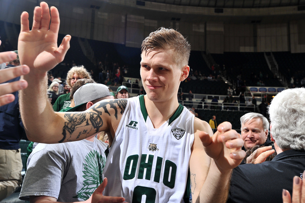 The Ohio Bobcats men's team's only senior, Treg Setty, gives high fives to fans as he walks off the court after a 103-96 win over Buffalo. Setty earned a career-high 24 points during the game. ©2016 Sarah Stier | Ohio Athletics