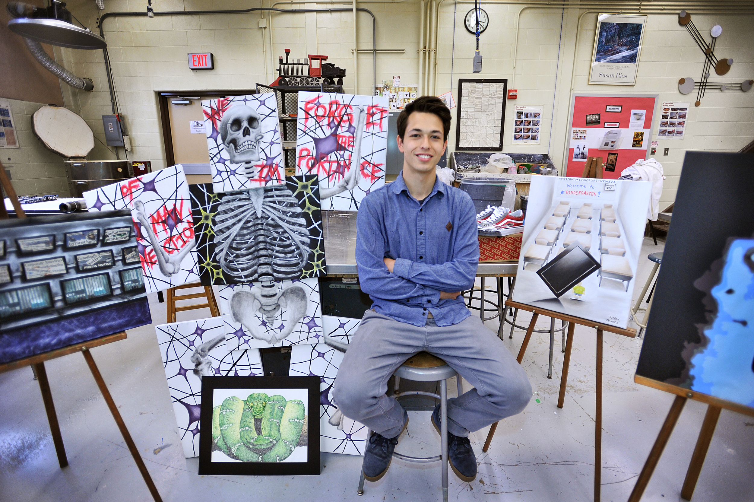 Jordan Mannix, a senior at Wilson High School, poses for a portrait on May 17, 2016, with some of his favorite pieces of artwork that he's done this year.
