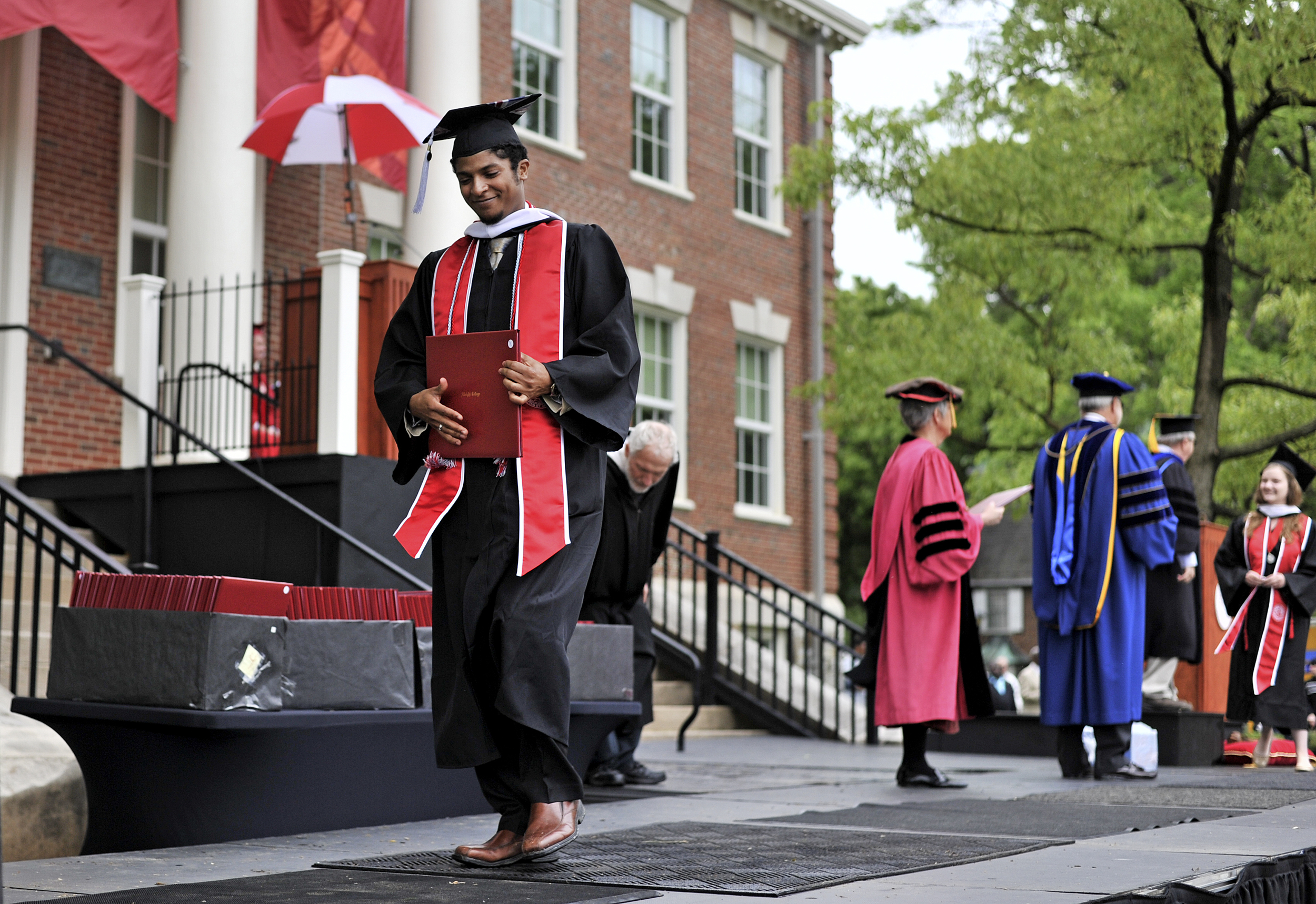 Alexio Kyoshi-Tuari Barboza receives his Bachelor of Arts degree at the Albright College commencement ceremony on May 22, 2016. (Reading Eagle: Sarah Stier)