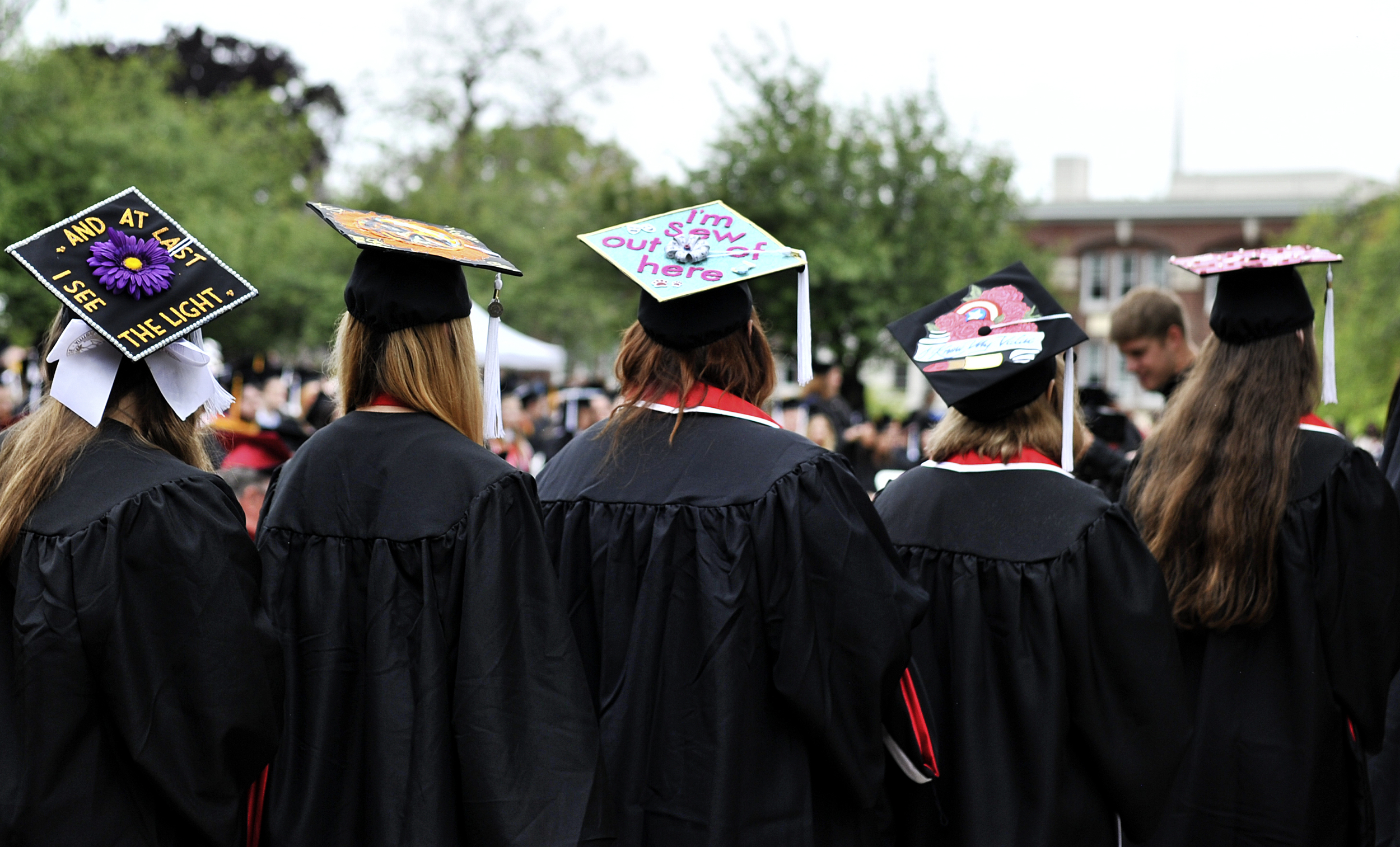 "Graduates at the Albright College commencement ceremony on May 22, 2016, wait to receive their degrees. ""I'm sew over it,"" reads one student's cap. (Reading Eagle: Sarah Stier)"