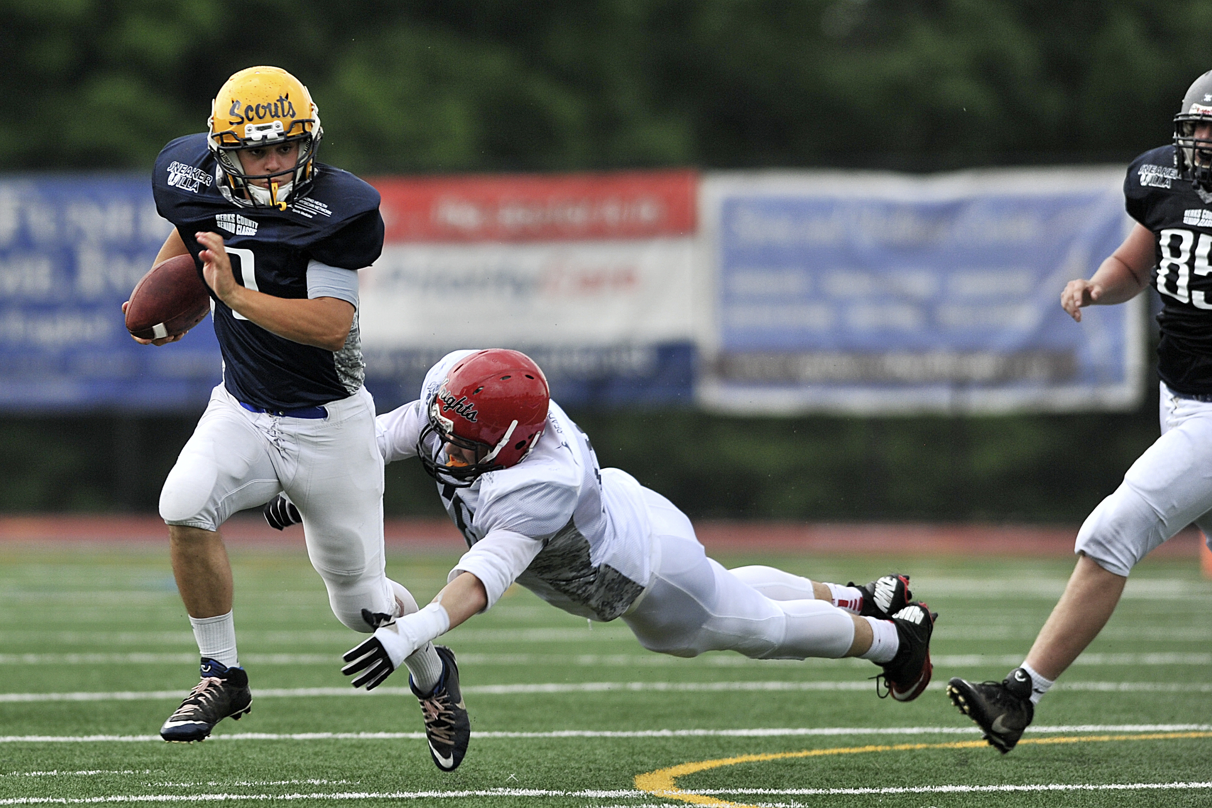 Cody Fidler of Muhlenberg runs the ball at the Berks Senior Football Game at Don Thomas Stadium in Exeter Township, PA, on June 5, 2016. (Reading Eagle: Sarah Stier)