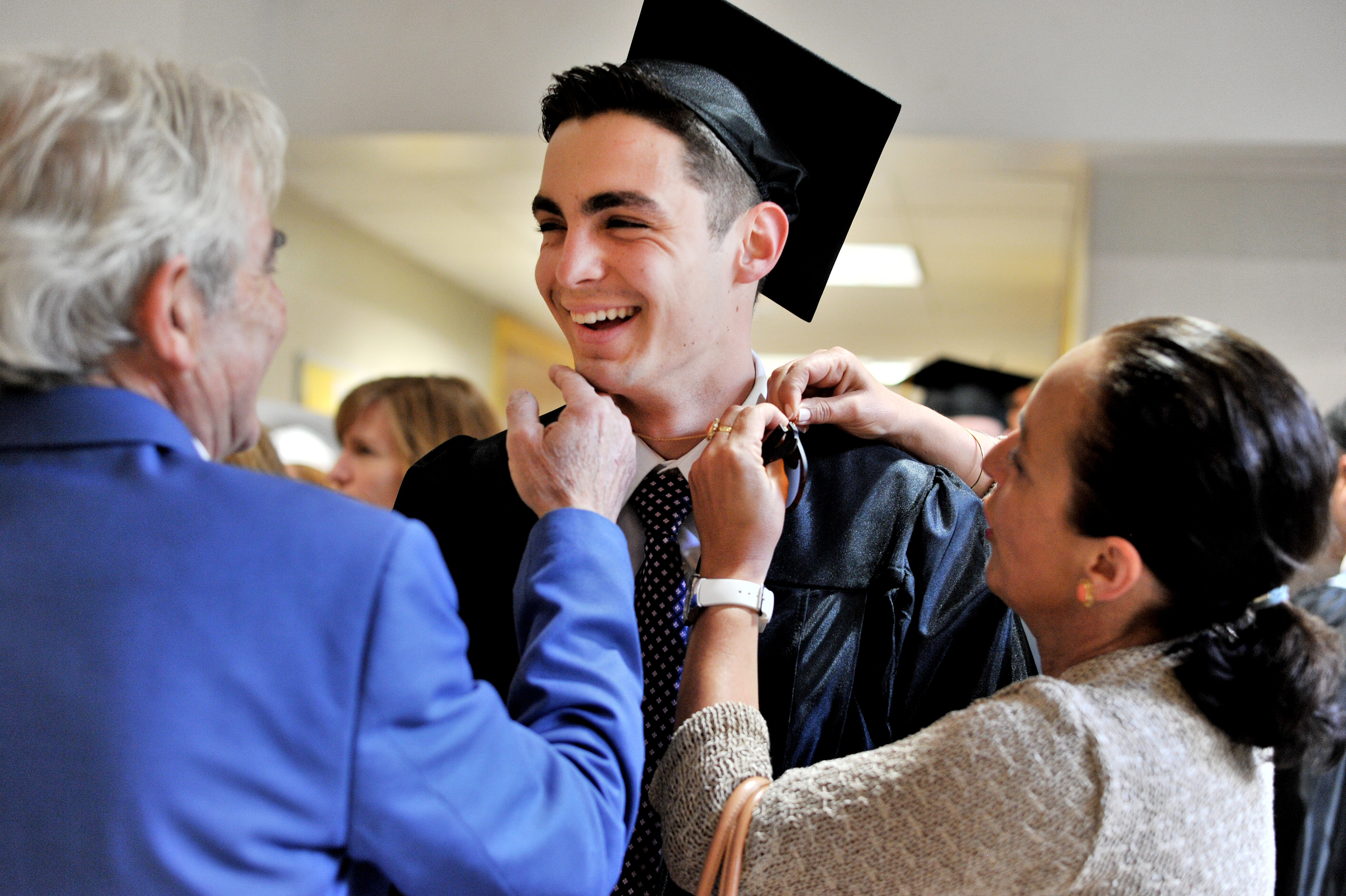 Juan Soria, 18, is greeted by his parents, Manuel and Magdalena, prior to the Berks Catholic High School graduation on June 8, 2016, at Alvernia University in Reading, PA. (Sarah Stier: Reading Eagle)