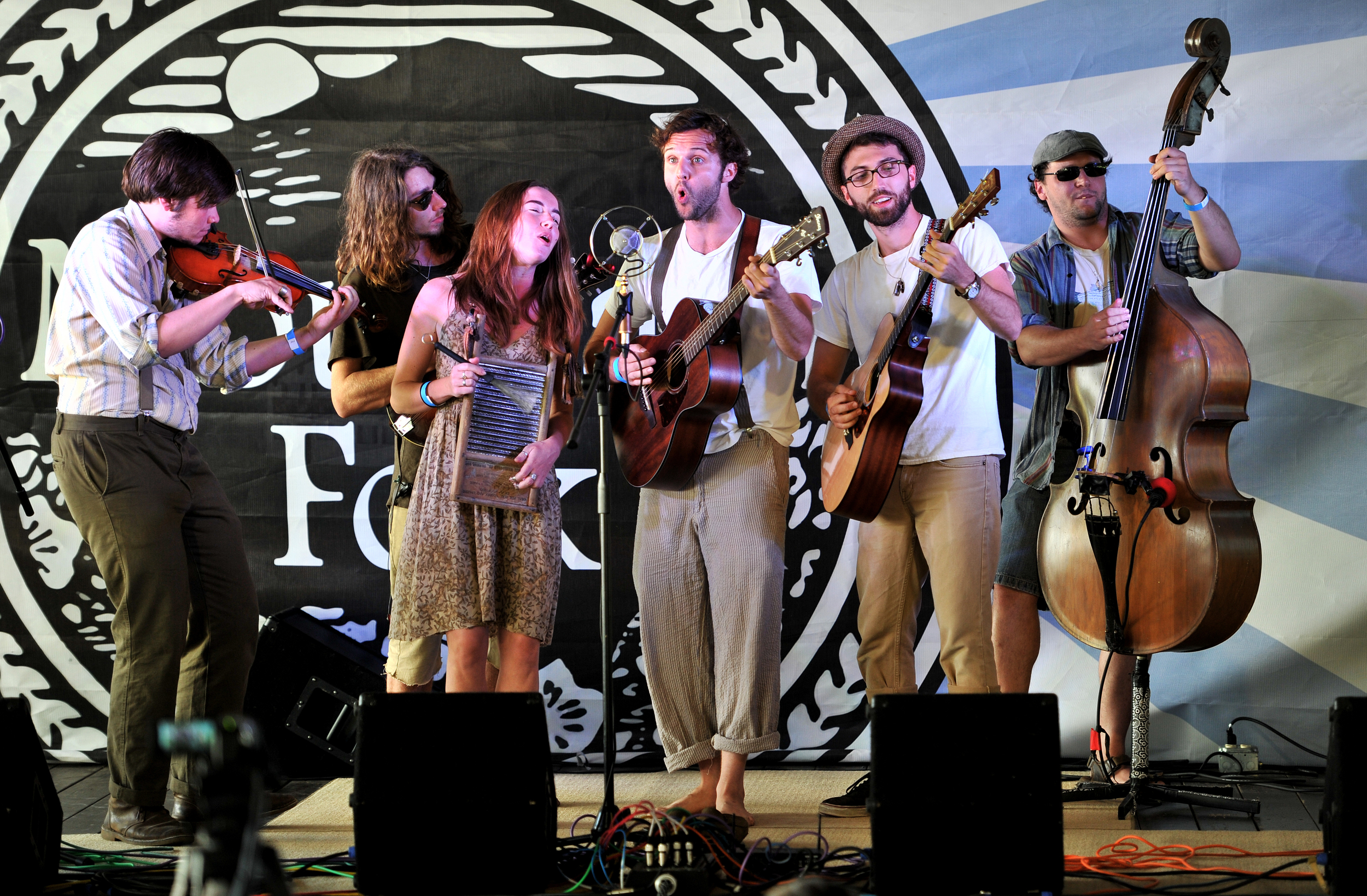 """Reading, Pennsylvania-based band """"Grexin"""" performs during the single-mic band competition at Mountain Folk Fest in Ruscombmanor Township, PA, on June 19, 2016. (Reading Eagle: Sarah Stier)"""
