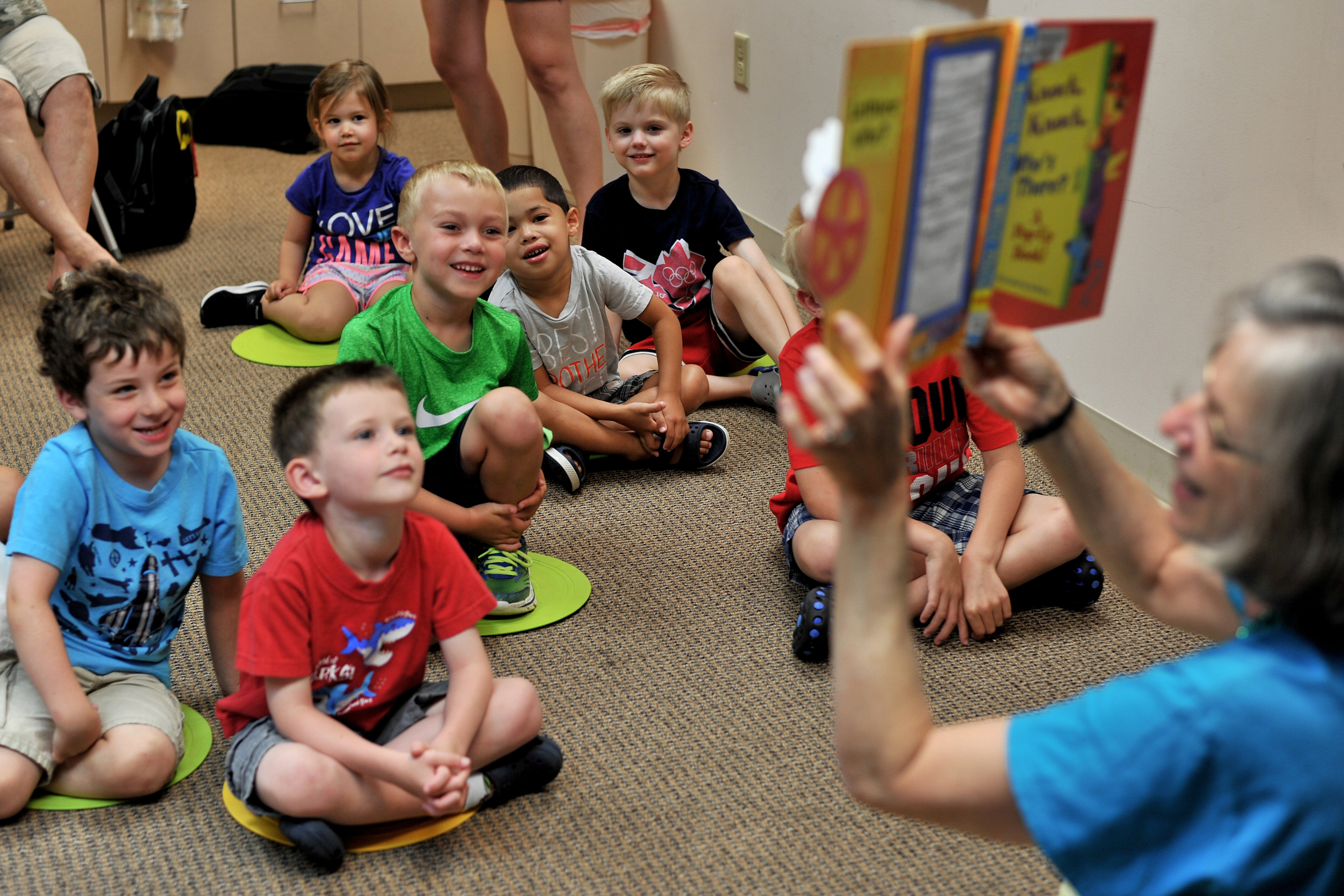 Patt McCloskey of Kutztown, PA, reads to kids during the StoryRiders Children's Program at West Lawn Wyomissing Hills Library in West Lawn, PA, on June 22, 2016. (Reading Eagle: Sarah Stier)
