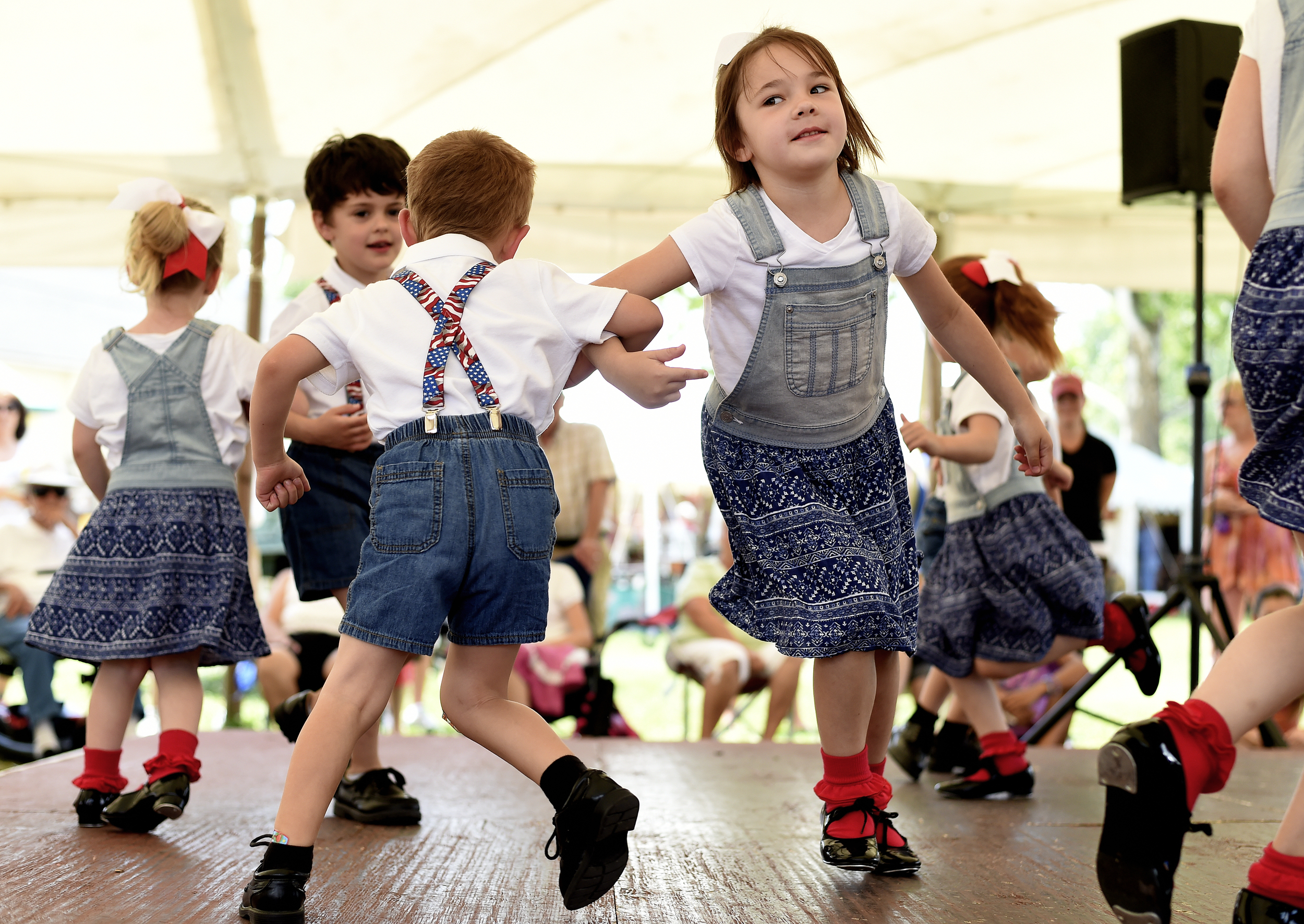Sarah Schaeffer, 6, of Kutztown dances with her partner Blake Losito, 4, of Hamburg at the Kutztown Folk Festival in Kutztown, PA, on July 6, 2016. (Reading Eagle: Sarah Stier)