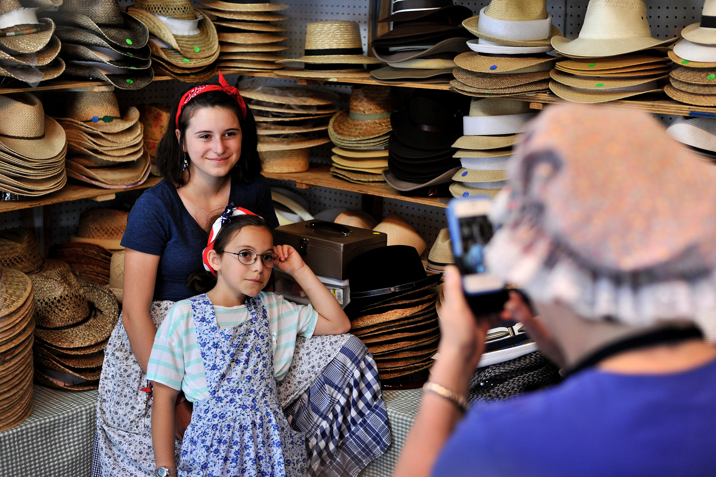 Andrea Neulight of Allentown takes a photo of her granddaughters Olivia Neulight, 13, and Journey Neulight, 10, of Venice, California, at the Kutztown Folk Festival in Kutztown, PA, on July 4, 2016. (Reading Eagle: Sarah Stier)