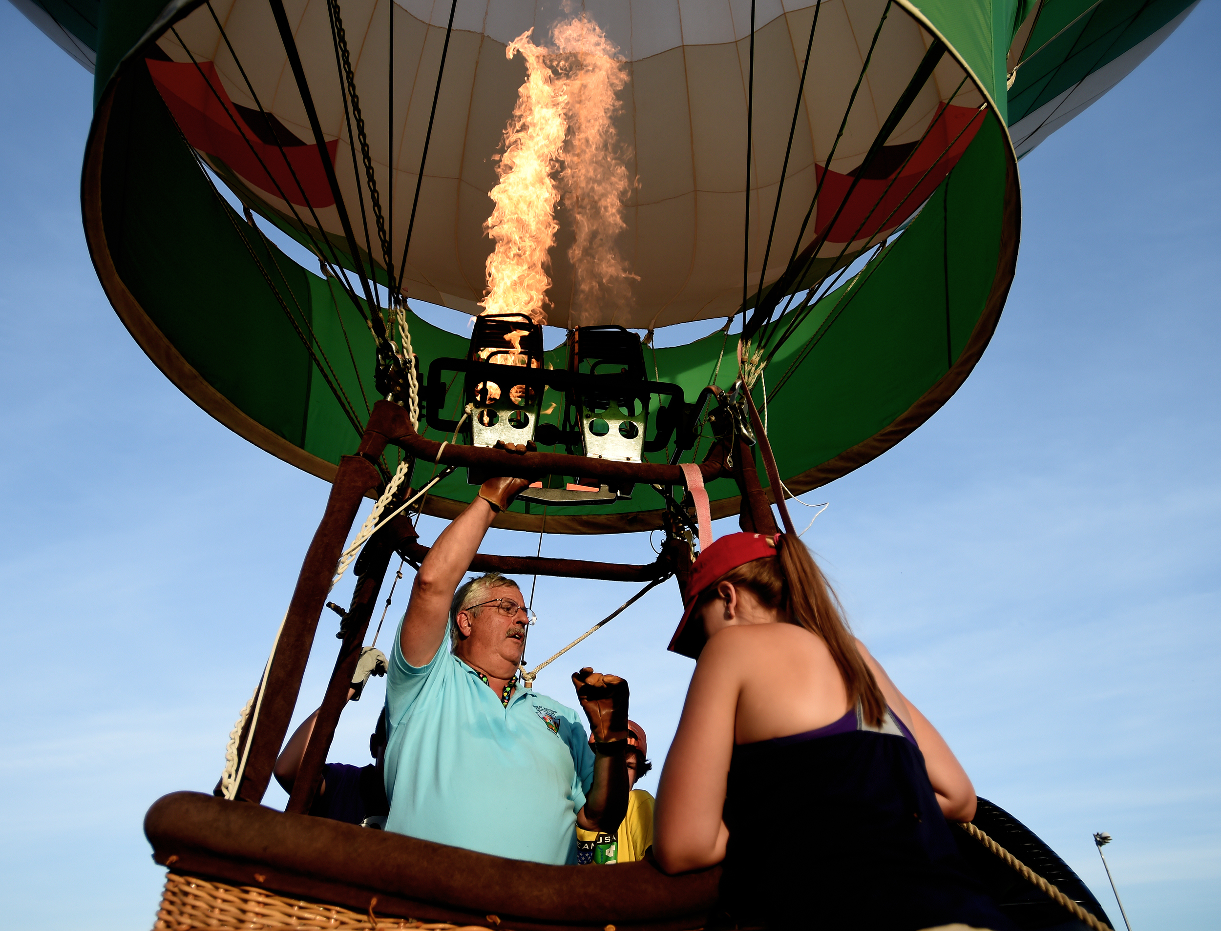 Steve Esser of Kutztown pumps hot air into his balloon during the Great Eastern Balloon Camp at Kutztown University in Kutztown, PA, on July 11, 2016. The balloon camp teaches youngsters the basics of flying hot balloons. (Reading Eagle: Sarah Stier)