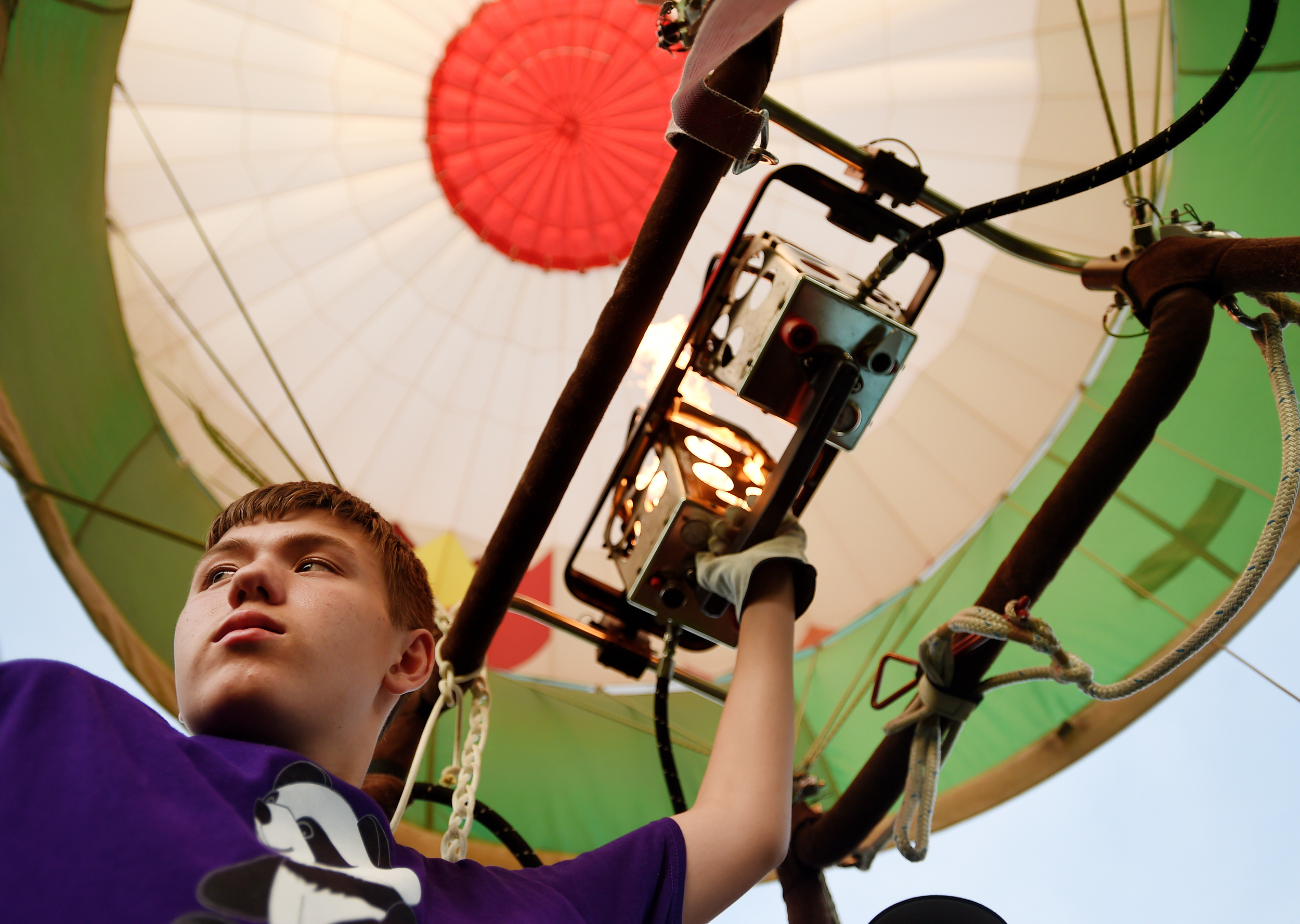 Jack Frankie, 13, of Bellport, NY, controls the hot air in a balloon during the Great Eastern Balloon Camp at Kutztown University in Kutztown, PA, on July 11, 2016. (Reading Eagle: Sarah Stier)