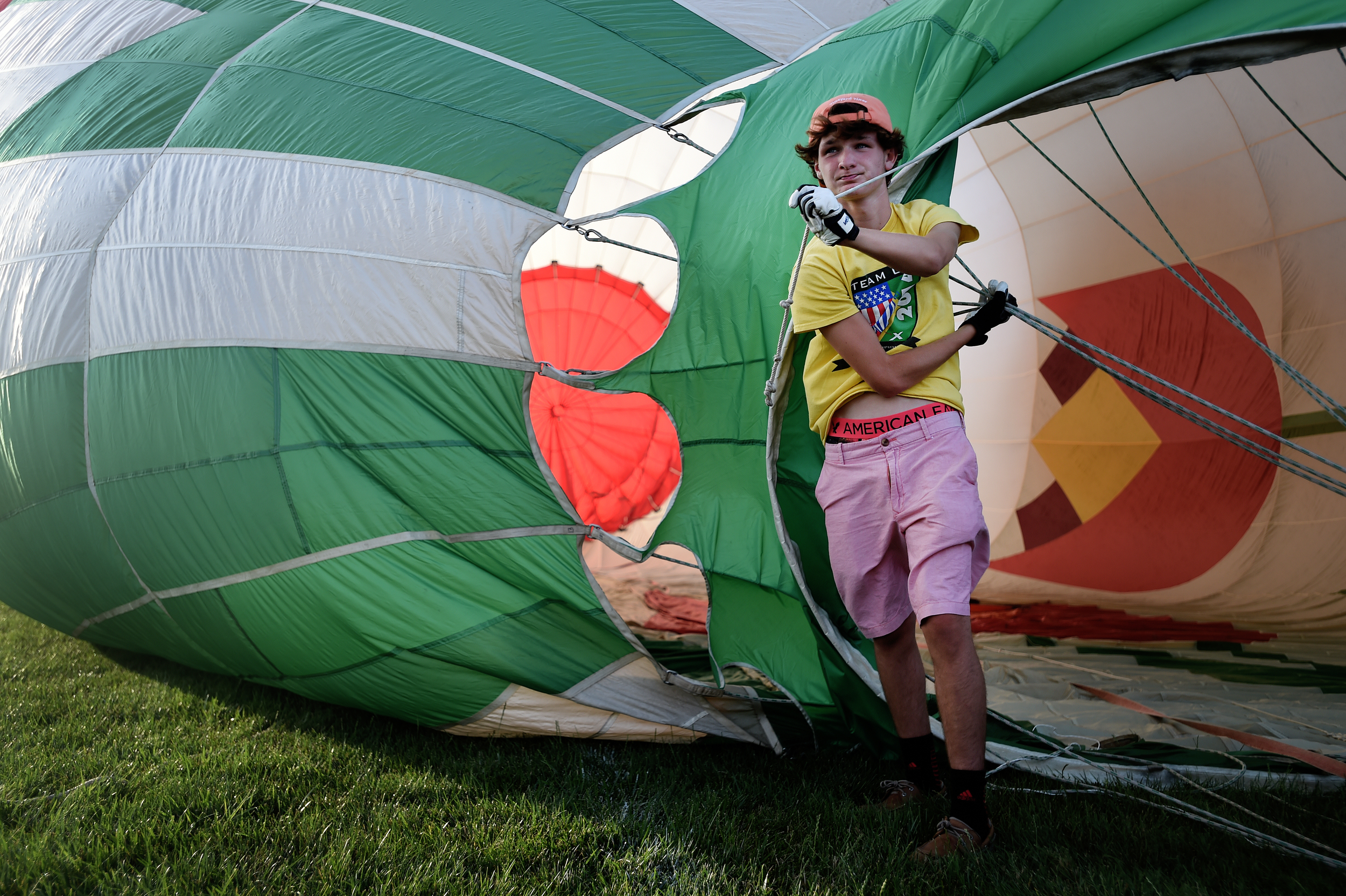 Christian Stison, 14, of Louisville, KY, helps inflate a hot air balloon during the Great Eastern Balloon Camp at Kutztown University in Kutztown, PA, on July 11, 2016. (Reading Eagle: Sarah Stier)