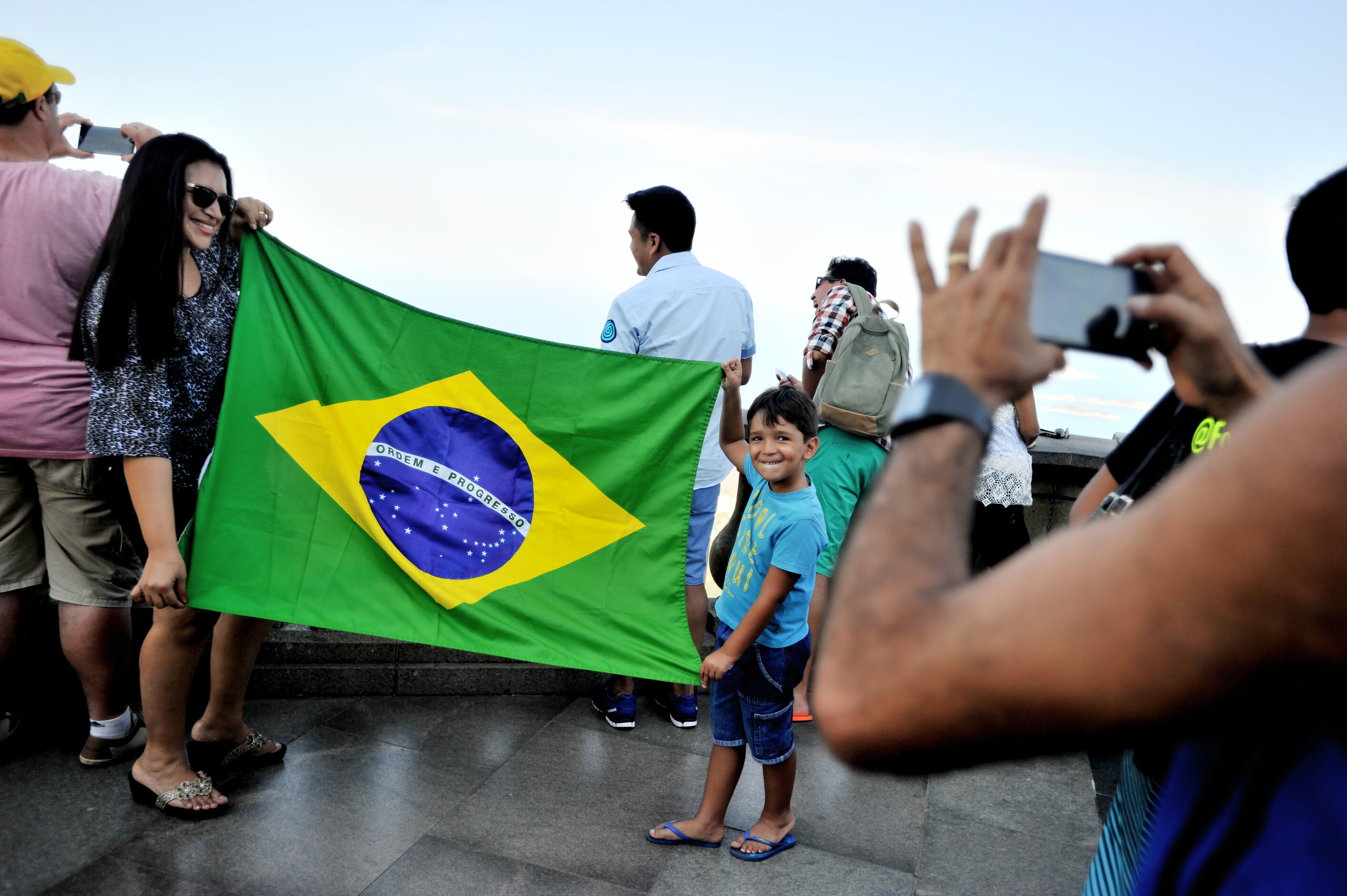 Denilza Rodrigues Dutua of Manaus and her son, Daniel, 5, pose with the Brazilian flag at the Statue of Christ the Redeemer in Rio de Janeiro, Brazil, on August 5, 2016. (Sarah Stier | Ball State at the Games)