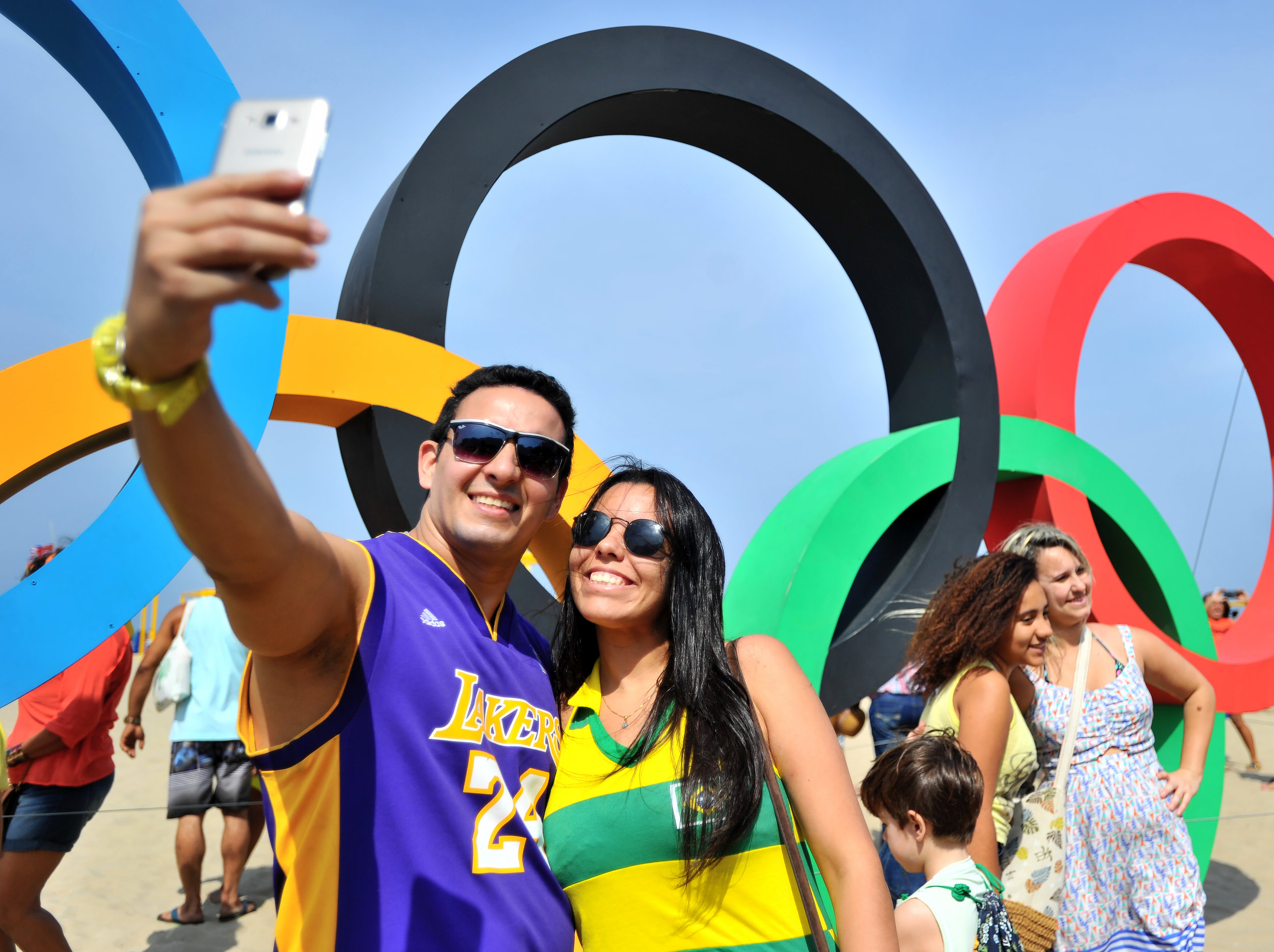 Roberto Patriota and Thamyus Sihra take a photo with the Olympic Rings at Copacabana Beach in Rio de Janeiro, Brazil, on August 7, 2016. (Sarah Stier | Ball State at the Games)