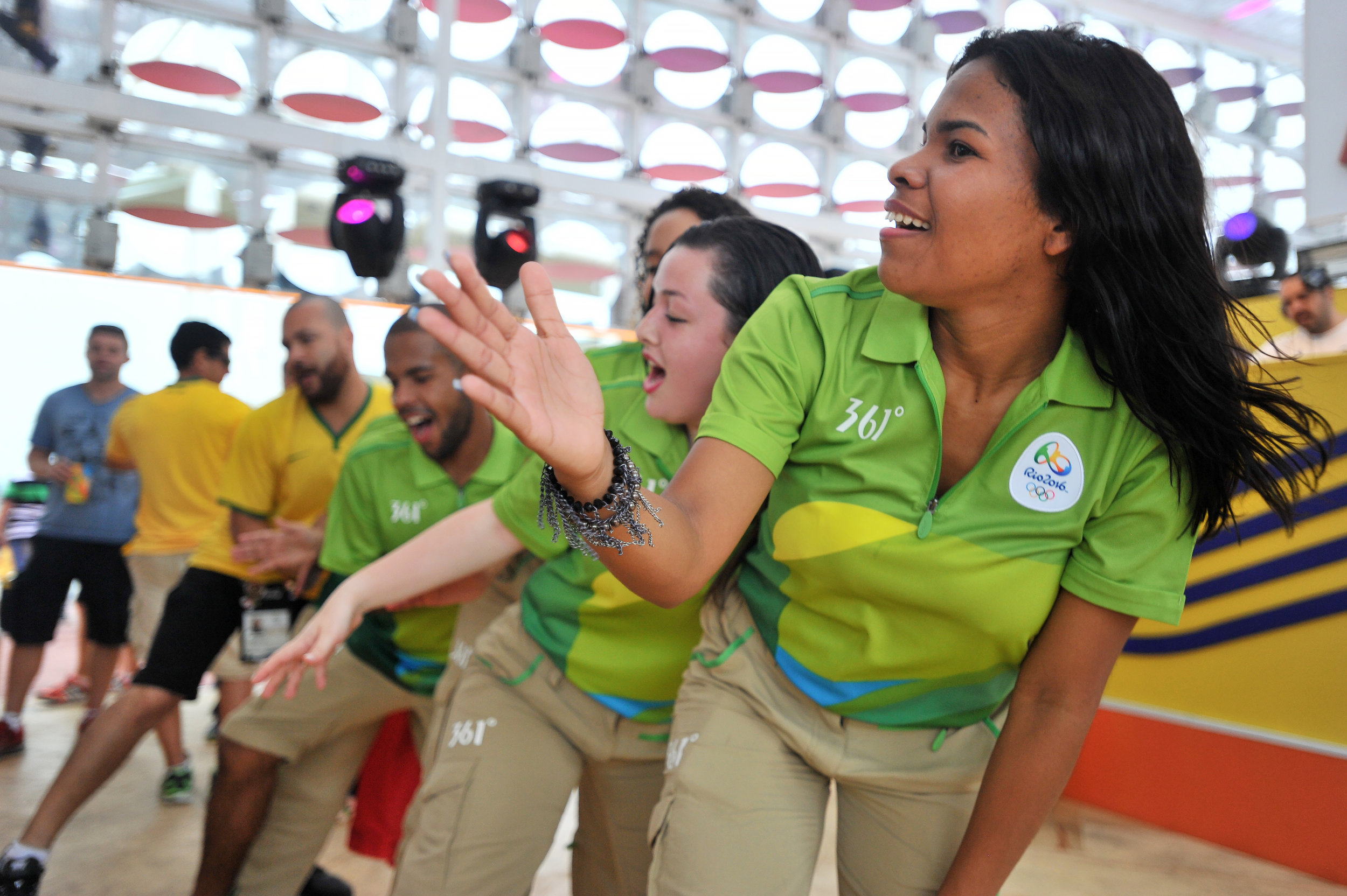 Olympic volunteers dance to pop music at the Olympic Park in Rio de Janeiro, Brazil, on August 8, 2016. (Sarah Stier | Ball State at the Games)