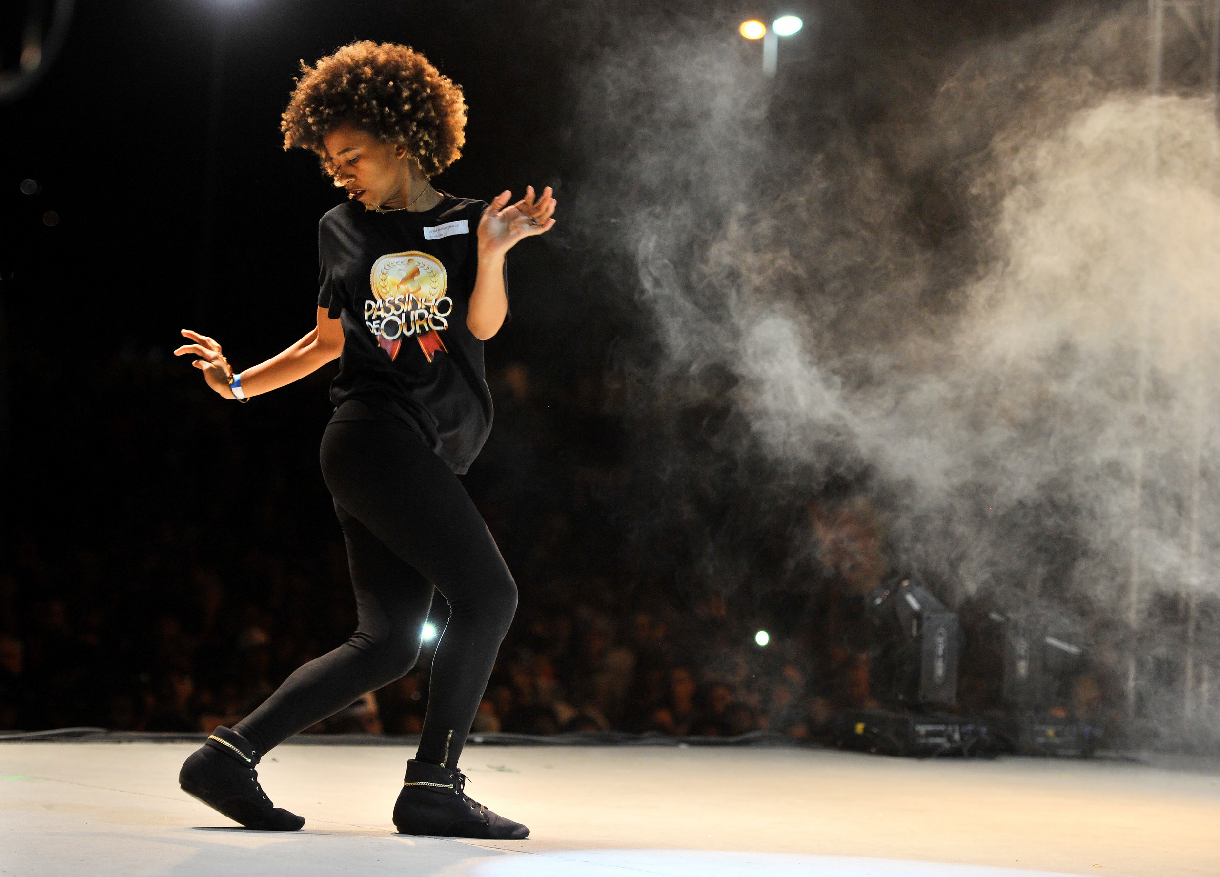 A woman dances the Passinho at Parque Madureira in Rio de Janeiro, Brazil, on August 13, 2016. This type of dance is similar to hip-hop and twerking in the United States.(Sarah Stier | Ball State at the Games)