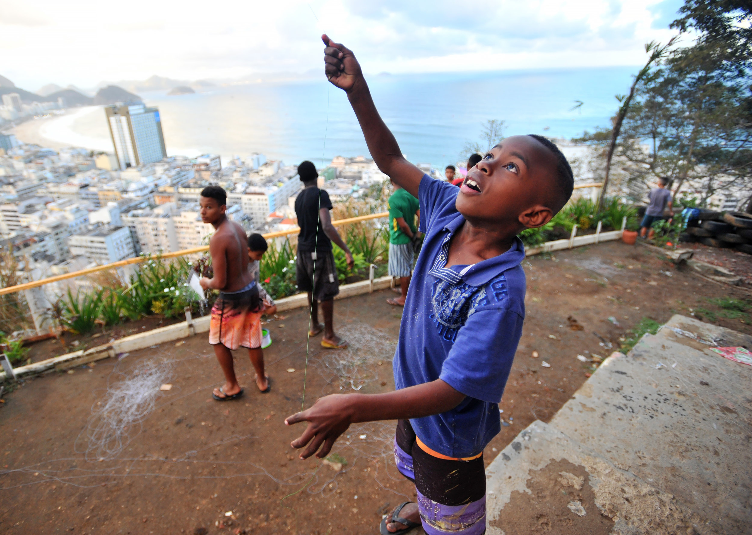 Gabriel Ignacio, 6, flies a kite in the favela that he lives in in Rio de Janeiro, Brazil, on August 12, 2016. The children build their own kites and attempt to catch their friends' kites in order to win the game. (Sarah Stier | Ball State at the Games)