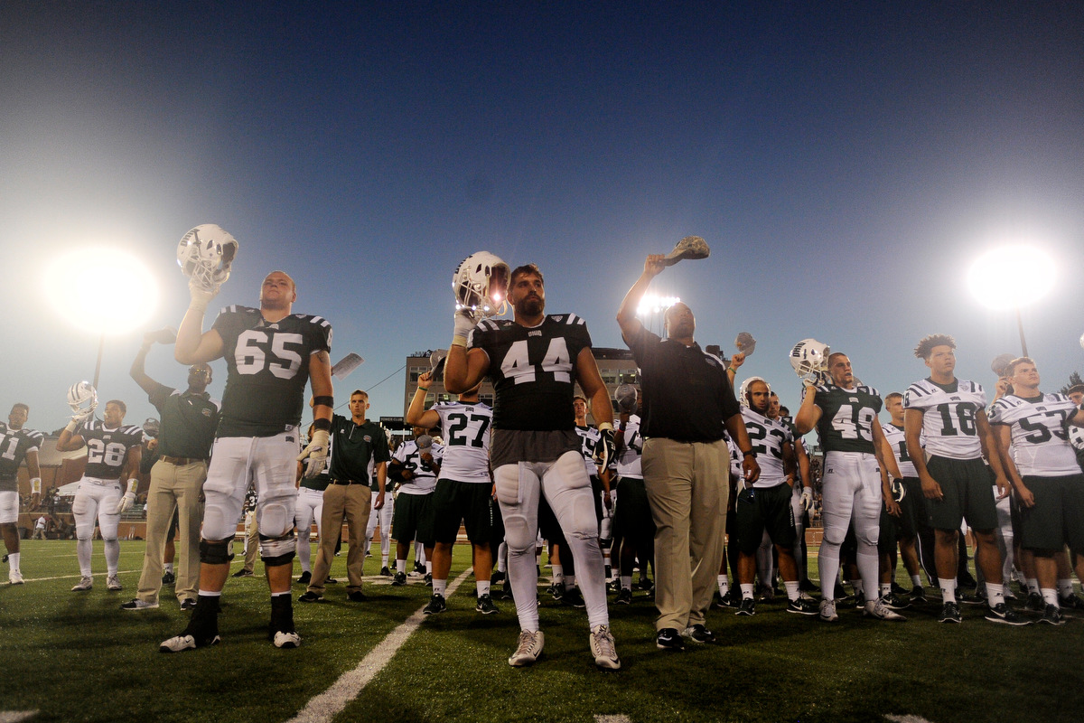 Ohio football players salute the band during the playing of the alma mater after the game against Texas State on September 3, 2016, in Athens, Ohio. After a back and forth game that went into triple overtime, the Bobcats dropped the game to Texas State 56-54.