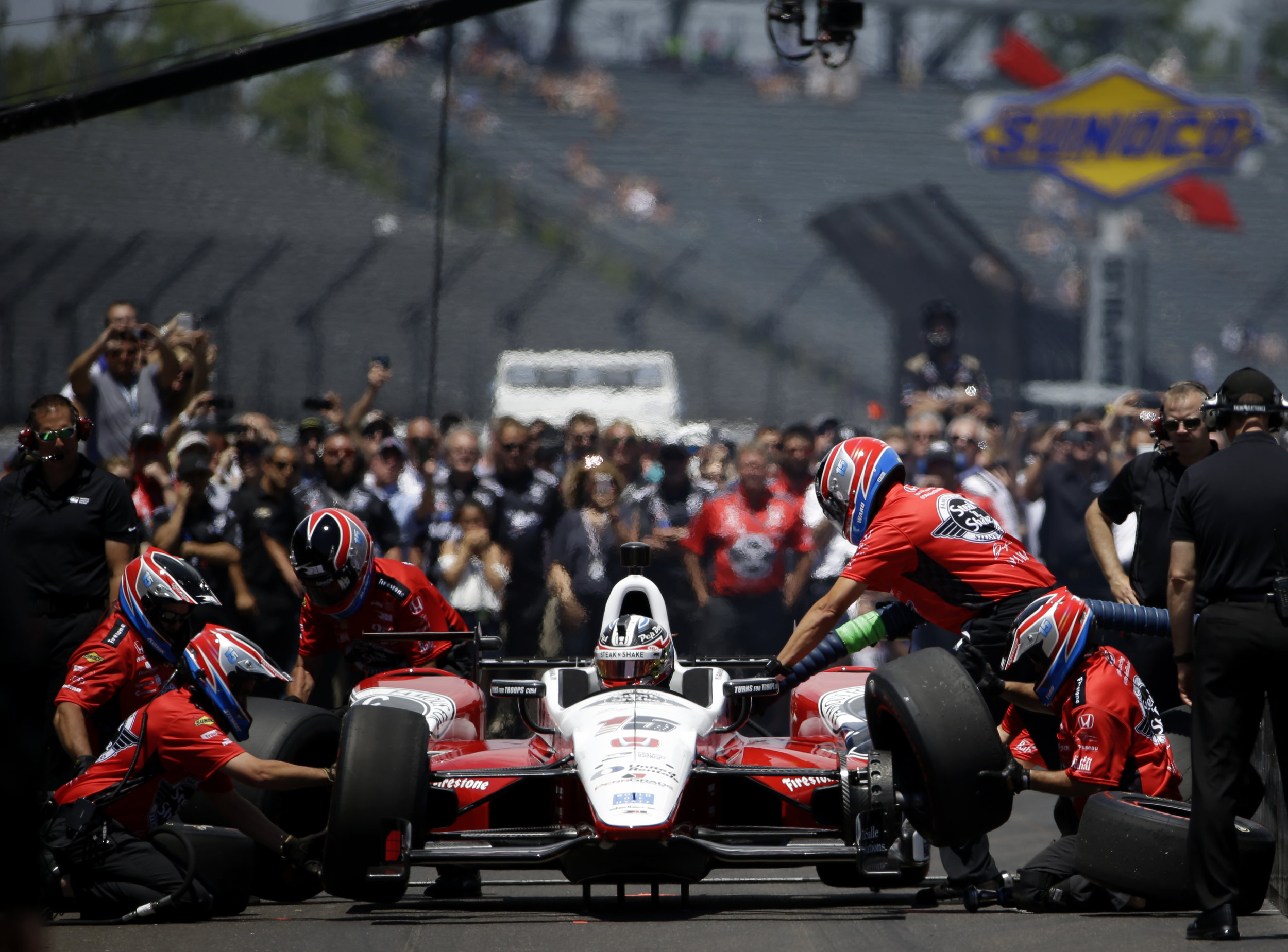 Crowds gather to watch as Graham Rahal's pit crew refuels and re-tires his car during the Indy 500 Pit Stop Challenge at Carb Day on Friday, May 26, 2017, for the 101st running of the Indy 500.