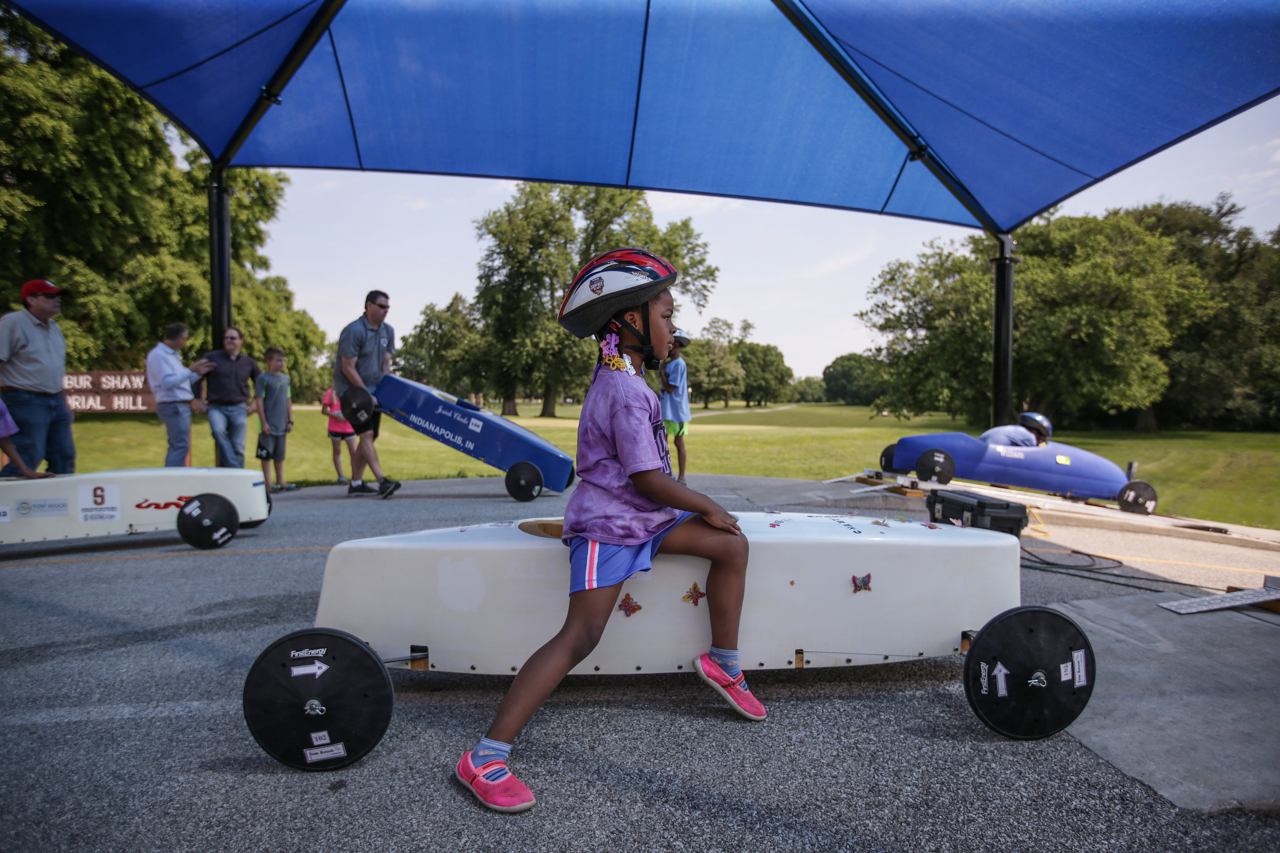 A young driver watches the start of another race while she waits for her own at the 15th Annual Mayor's Cup on Saturday, June 3, 2017.