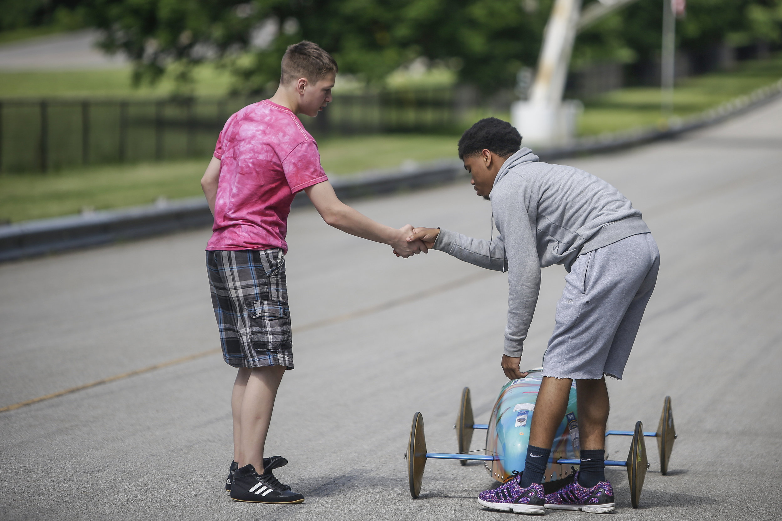 Joseph Flynn (left), 13, shakes his competitor, Geordan Wells', 16, hand after their race at the 15th Annual Mayor's Cup on Saturday, June 3, 2017.