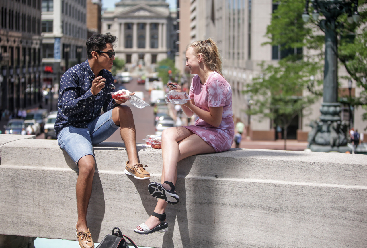 Vivian Grant, 17, and Michael Catano enjoy strawberry shortcake on a ledge of Monument Circle at the 52nd Annual Strawberry Festival in downtown Indianapolis on Thursday, June 8, 2017.